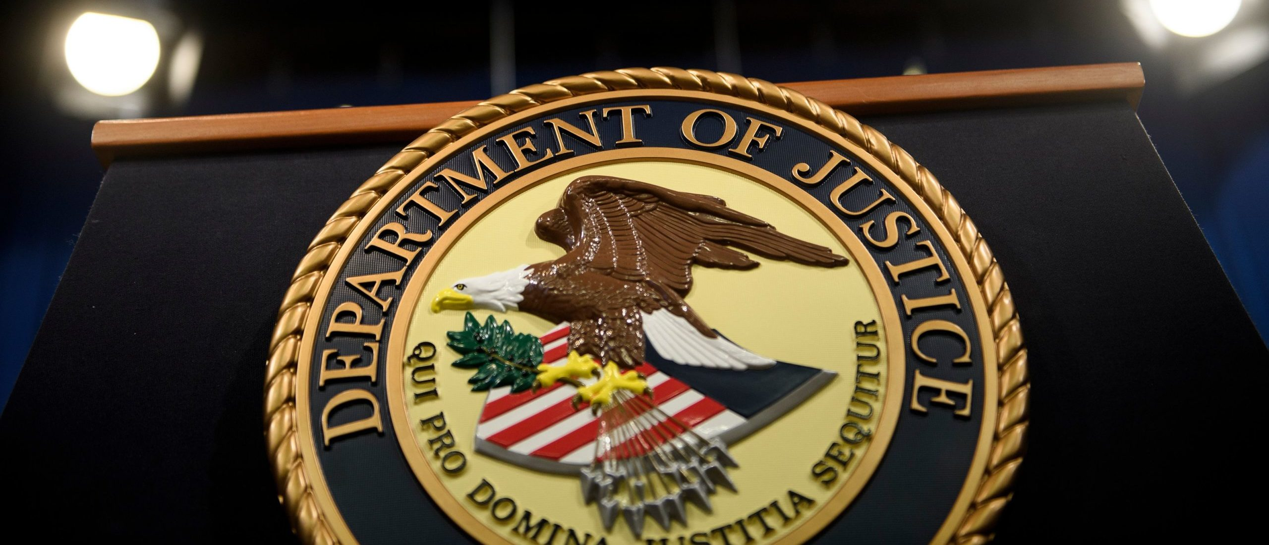 Department of Justice lectern in Washington, DC.