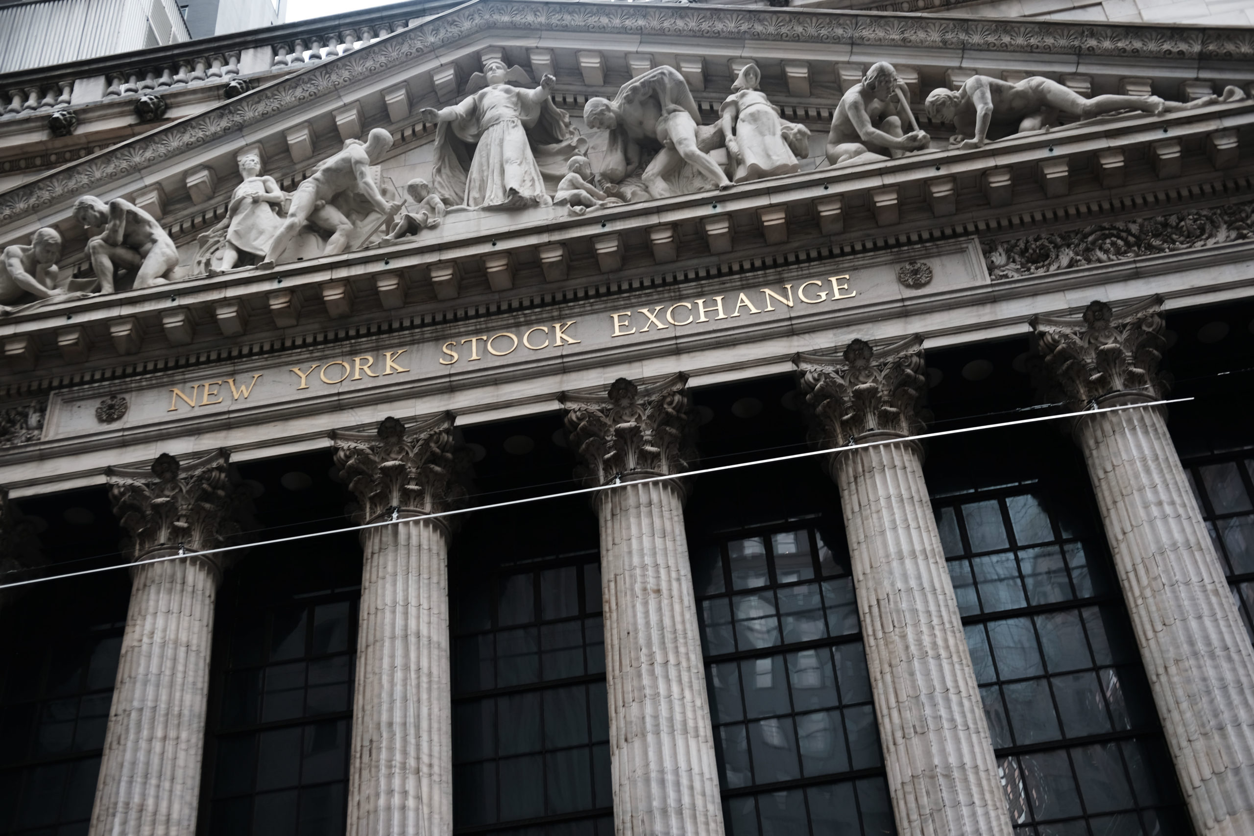 NEW YORK, NEW YORK - JANUARY 03: The New York Stock Exchange (NYSE) stands in lower Manhattan on January 03, 2019 in New York City. As a decline in Apple product sales in China continues to depress global markets, the Dow Jones Industrial Average fell over 200 points in morning trading. (Photo by Spencer Platt/Getty Images)
