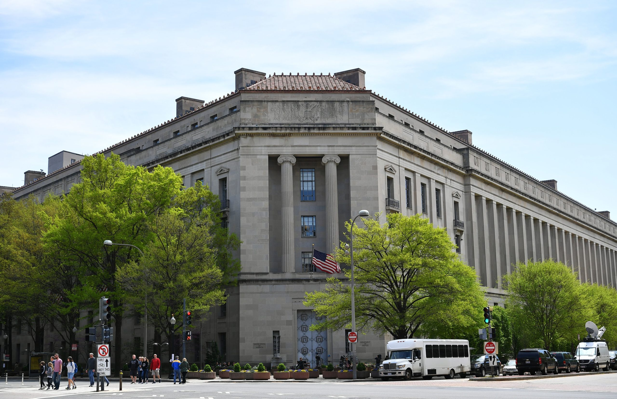 An April 16, 2019 photo shows the Department of Justice in Washington, DC. - A redacted version of special counsel Robert Mueller's report into Russian meddling in the US election will be released on April 18, 2019, the Justice Department said as President Donald Trump again lashed out at the most politically explosive probe in modern US history. The report could feature allegations that Trump tried to obstruct the investigation, although Attorney General Bill Barr has said there is not sufficient evidence to establish he committed such a crime. Mueller himself has offered no conclusion on this, according to a brief summary of the report from Barr, who was handpicked by Trump. (Photo by MANDEL NGAN / AFP) (Photo by MANDEL NGAN/AFP via Getty Images)
