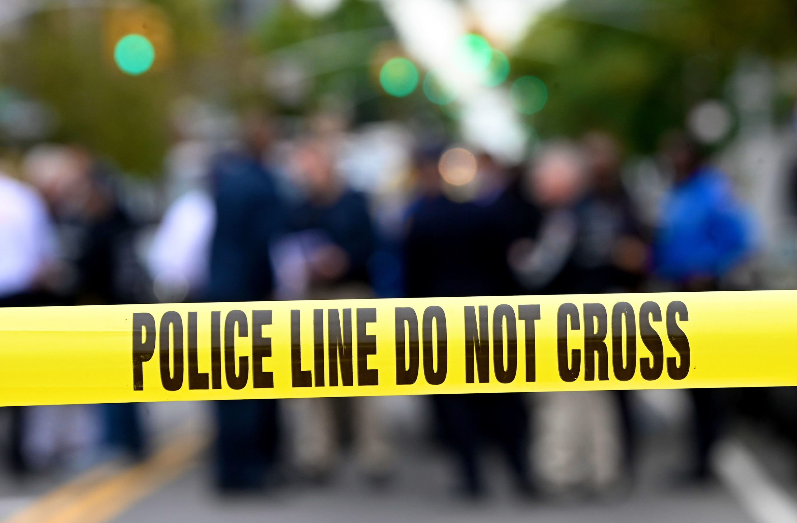 Police tape secures a crime scene outside a club after a shooting in Brooklyn on October 12, 2019. - At least four people died and three were wounded in a shooting at a social club in New York eary Saturday, police said. No one has been arrested over the shooting, which took place in Brooklyn, and the motive and exact circumstances are not known, a New York police official told AFP. The local affiliate of ABC News described the place where the shooting took place as an after-hours club. (Photo by Johannes EISELE / AFP) (Photo by JOHANNES EISELE/AFP via Getty Images)