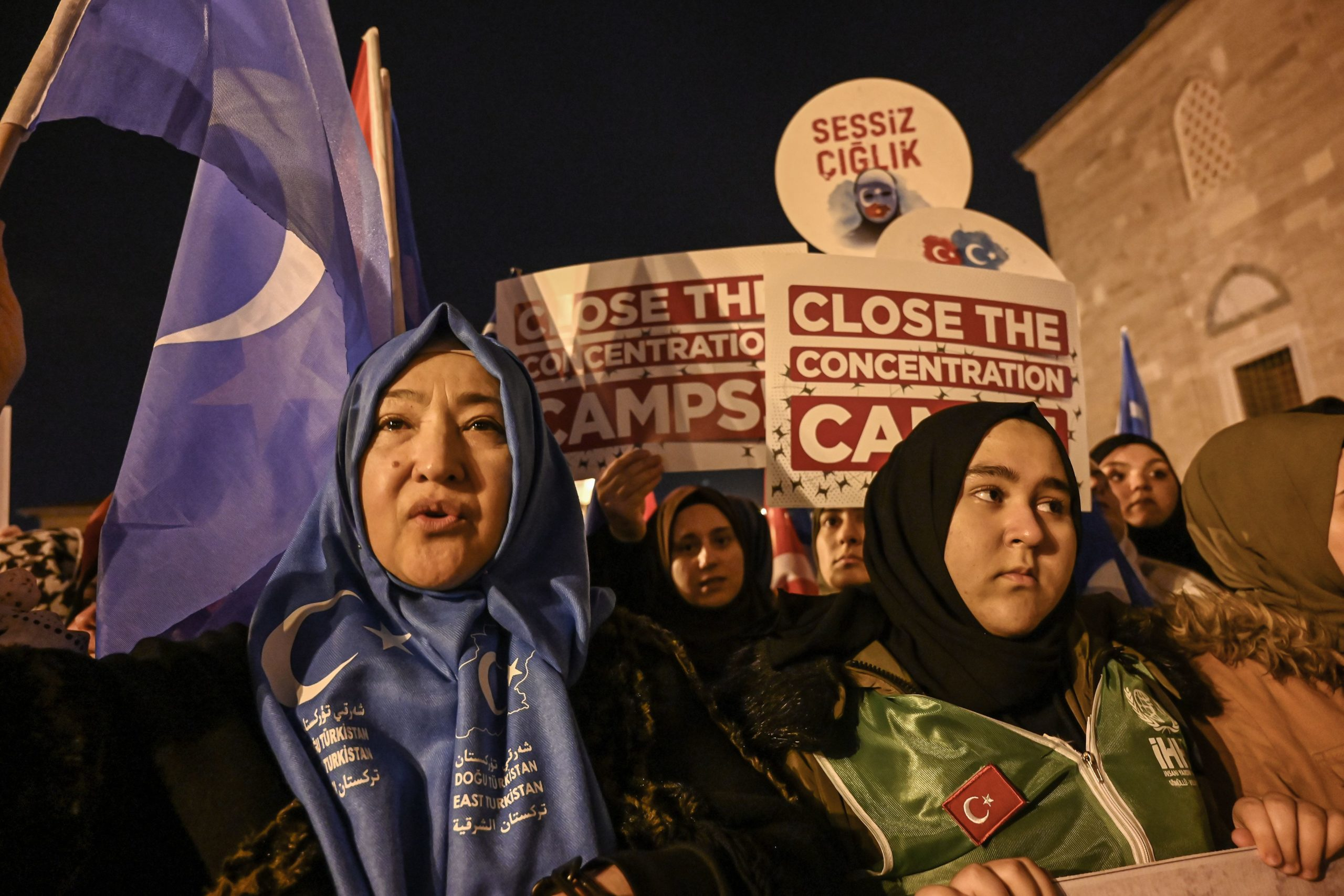 Supporters of China's Muslim Uighur minority wave the flag of East Turkestan and hold placards on December 20, 2019 during a demostration at Fatih in Istanbul. - More than 1,000 protesters marched Friday in Istanbul to protest against China over its treatment of mainly Muslim Uighurs in Xinjiang, an AFP correspondent said.They called for an end to the crackdown in China's northwestern region, where upwards of one million Uighurs and other mostly Muslim minorities are believed to be held in re-education camps. (Photo by Ozan KOSE / AFP) (Photo by OZAN KOSE/AFP via Getty Images)