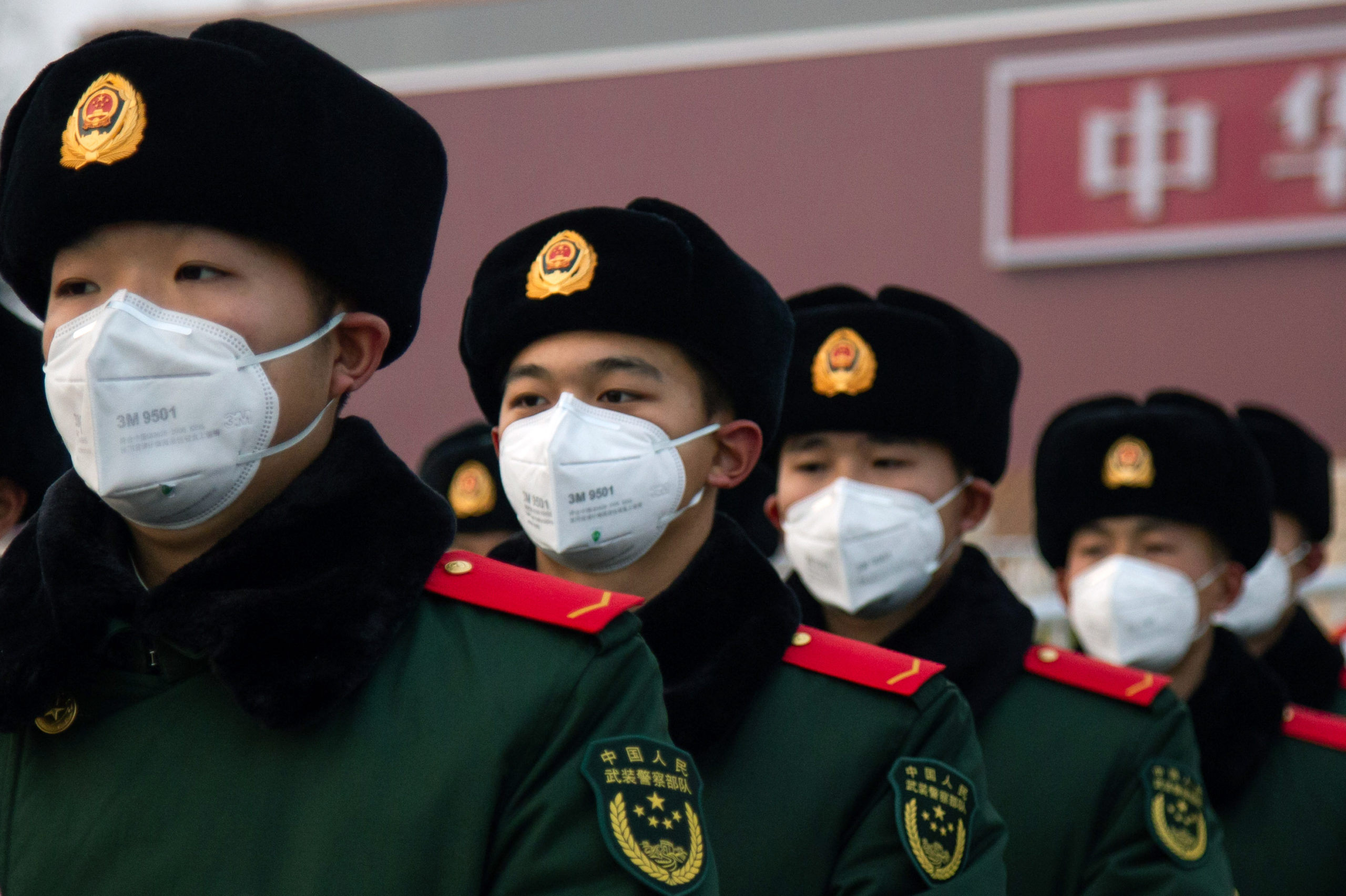 BEIJING, CHINA - JANUARY 26: Chinese police officers wearing masks stand in front of the Tiananmen Gate on January 26, 2020 in Beijing, China. The number of cases of coronavirus rose to 1,975 in mainland China on Sunday. Authorities tightened restrictions on travel and tourism this weekend after putting Wuhan, the capital of Hubei province, under quarantine on Thursday. The spread of the virus corresponds with the first days of the Spring Festival, which is one of the biggest domestic travel weeks of the year in China. Popular tourism landmarks in Beijing including the Forbidden City, Badaling Great Wall, and The Palace Museum were closed to the public starting Saturday. The Beijing Municipal Education Commission announced it will delay reopening schools from kindergarten to university. The death toll on Sunday rose to 56. The majority of fatalities are in Wuhan where the first cases of the virus were reported last month (Photo by Betsy Joles/Getty Images)