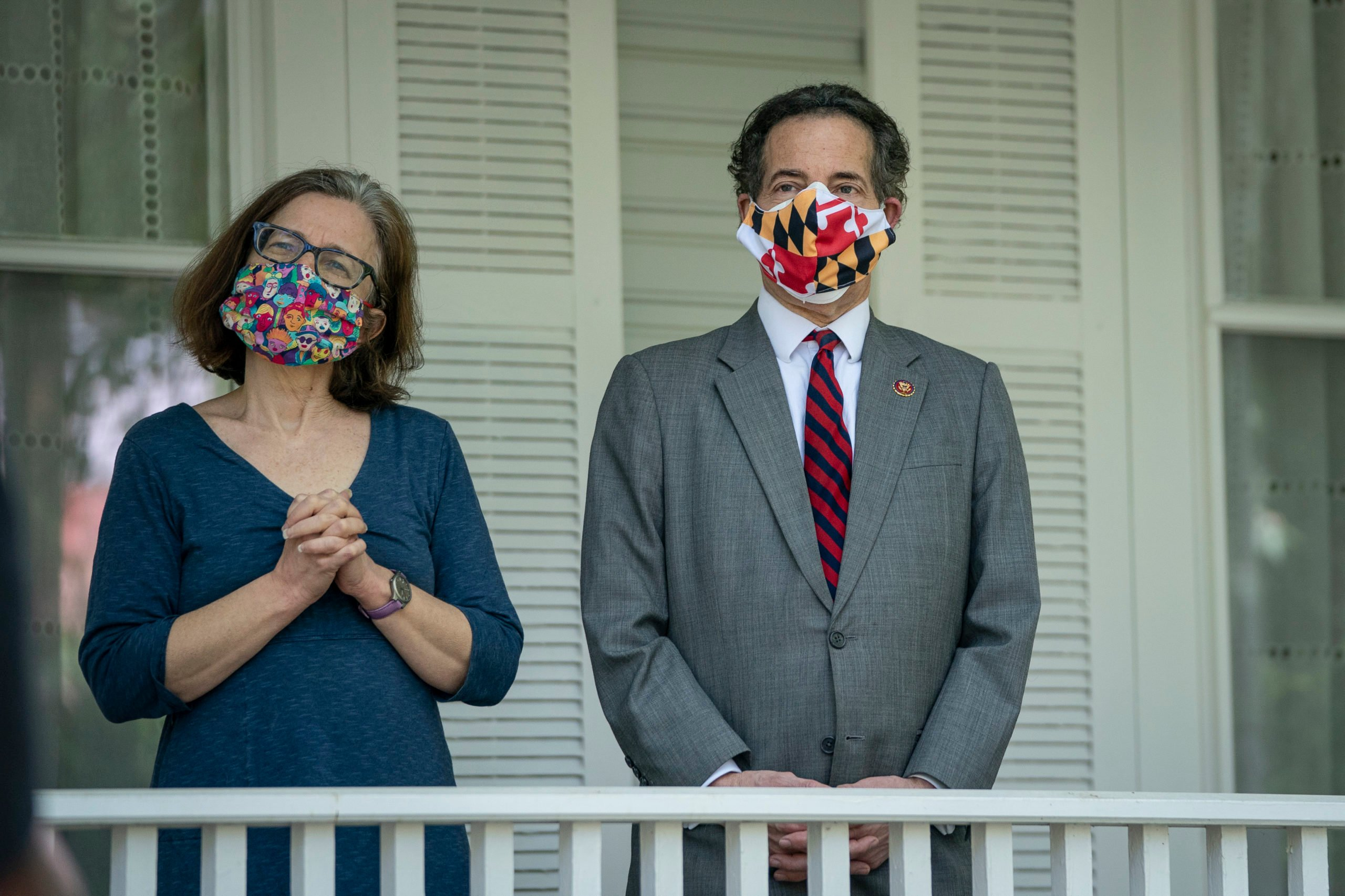 TAKOMA PARK, MD - MAY 04: (L-R) Sarah Bloom Raskin and U.S. Rep. Jamie Raskin (D-MD) listen as a group of Maryland residents, calling themselves the 'Pandemic Comforters,' sing in the front yard of his home on May 4, 2020 in Takoma Park, Maryland. The singers wanted to use the nice weather to show gratitude to Rep. Raskinfor his work in Congress and offer their prayers during the coronavirus pandemic. Last week, Rep. Raskin was appointed by Speaker of the House Nancy Pelosi to the newly created House Select Committee On Coronavirus. (Photo by Drew Angerer/Getty Images)