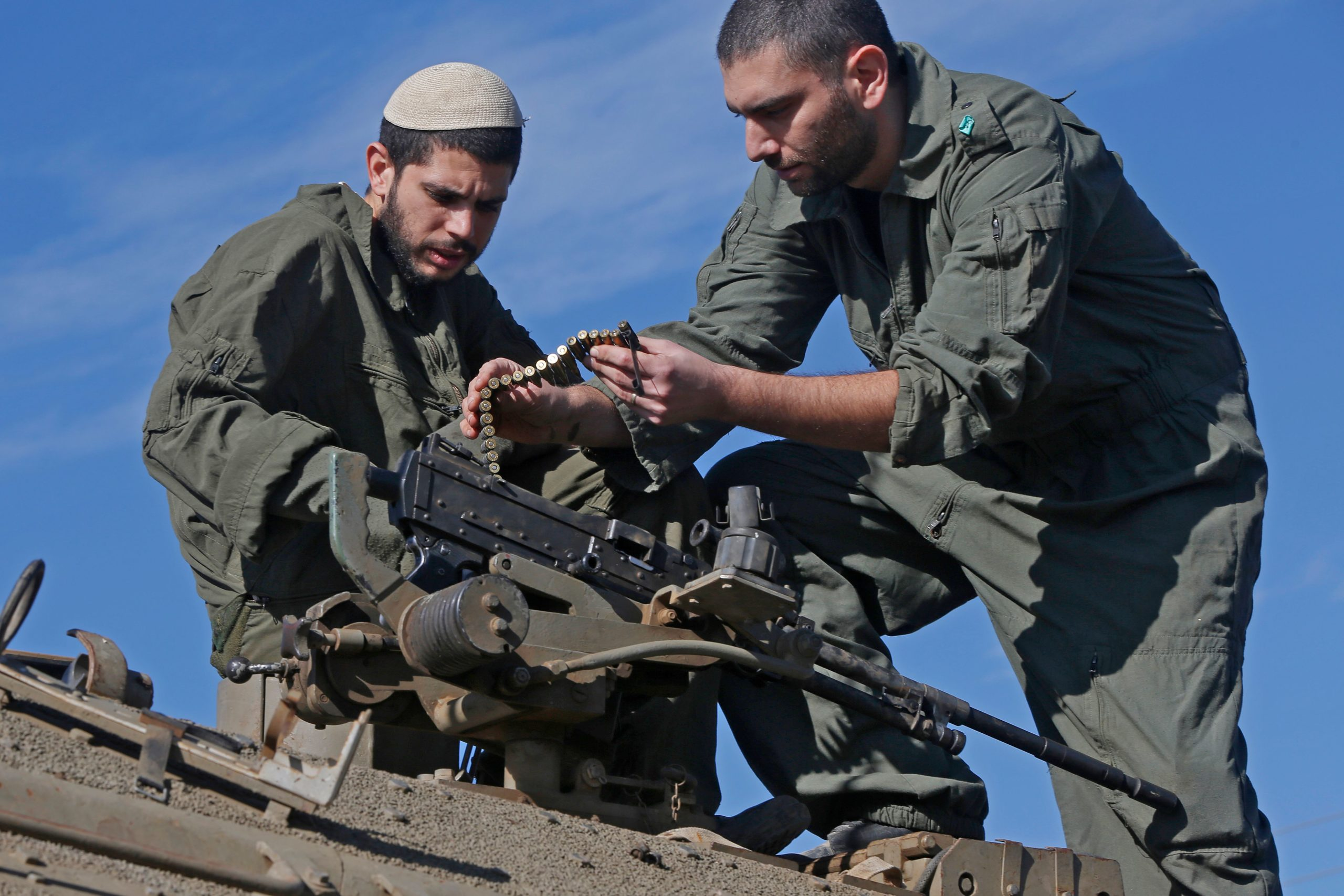 A picture taken on November 25, 2020 shows Israeli soldiers preparing a tank near the Israel-Syria border, in the Israeli-annexed Golan Heights. - Israeli air strikes in Syria overnight killed at least eight fighters operating in pro-Iran militias, a war monitoring group said. The strikes targeted an arms depot and a position held by Iranian forces and their Lebanese ally Hezbollah near the capital Damascus, and a pro-Iran militia position in southern Syria, the Syrian Observatory for Human Rights said. (Photo by JALAA MAREY / AFP) (Photo by JALAA MAREY/AFP via Getty Images)