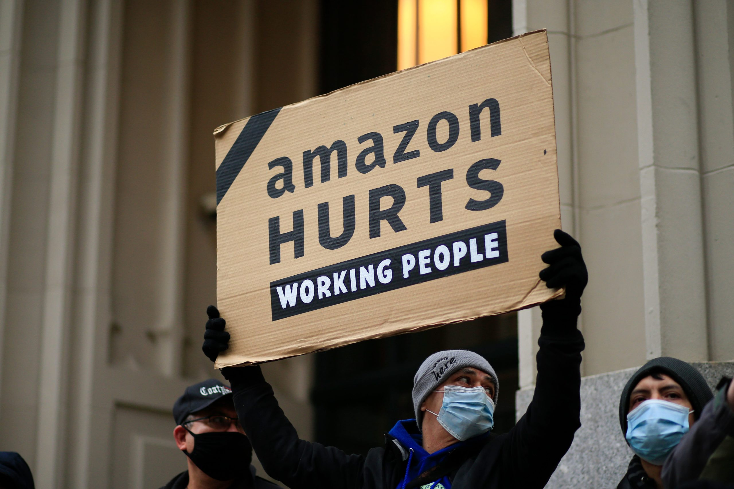 Amazon workers and community allies demonstrate during a protest organized by New York Communities for Change and Make the Road New York in front of the Jeff Bezos' Manhattan residence in New York on December 2, 2020. (Photo by Kena Betancur / AFP) (Photo by KENA BETANCUR/AFP via Getty Images)