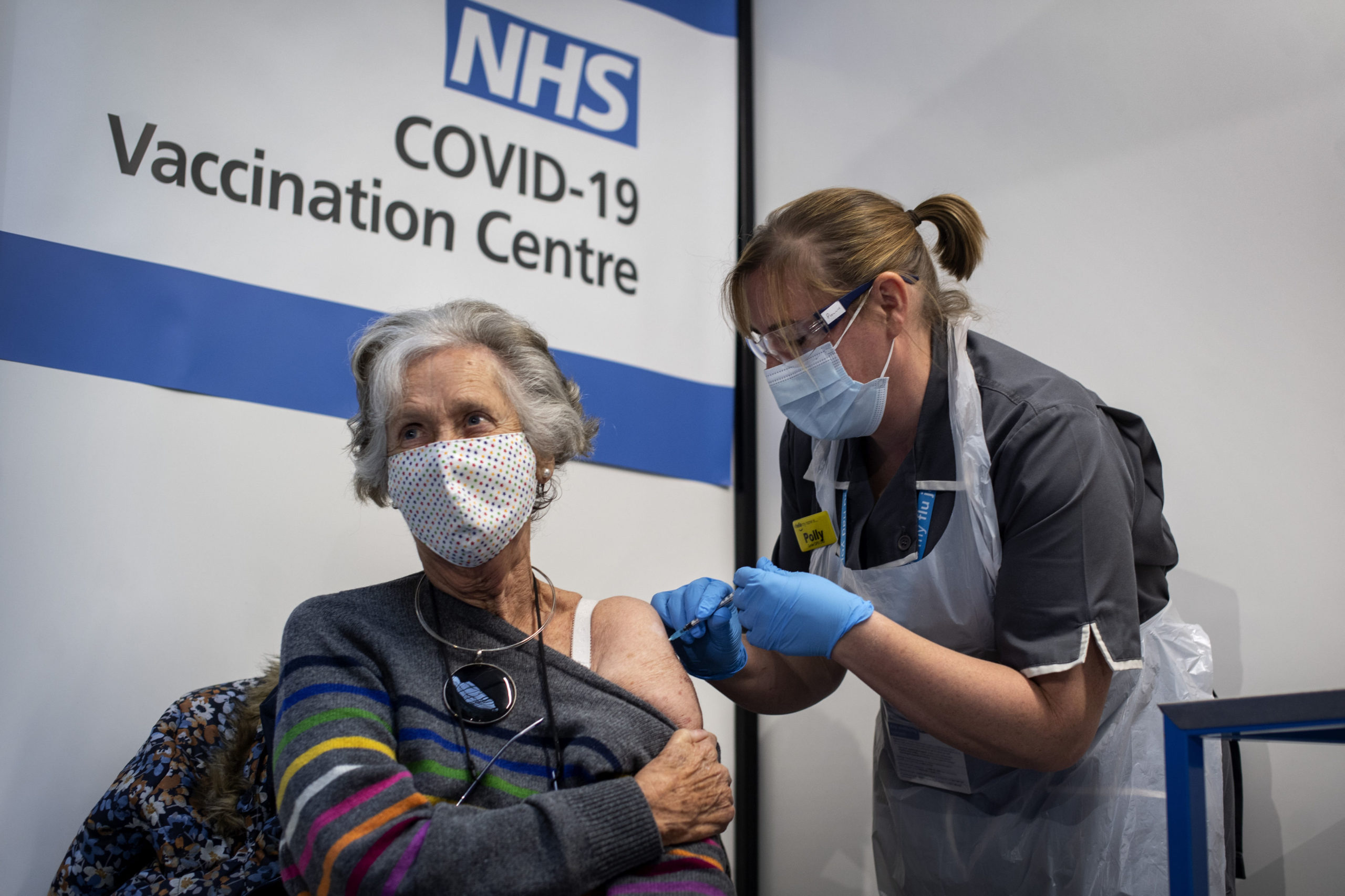 A British woman receives the first of two vaccine doses on Dec. 8 in London. (Victoria Jones/Pool/Getty Images)