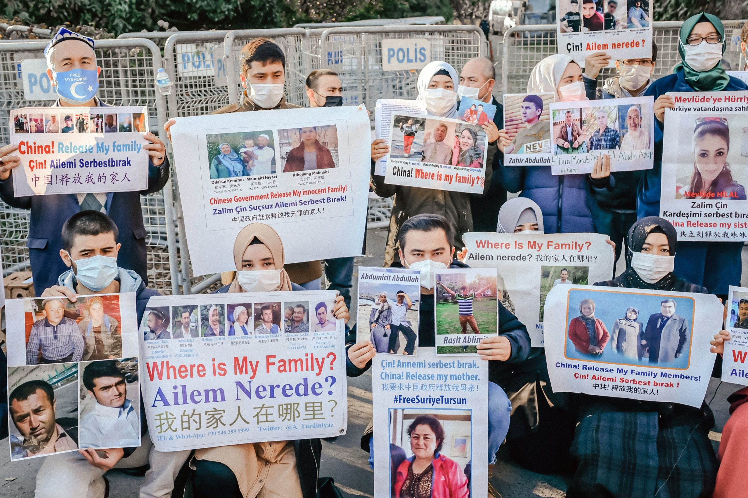 "Members of the Muslim Uighur minority hold placards as they demonstrate in front of the Chinese consulate on December 30, 2020, in Istanbul, to ask for news of their relatives and to express their concern after China announced the ratification of an extradition treaty with Turkey. - The Chinese parliament ratified on December 26, 2020 an extradition treaty signed in 2017 with Ankara, a text that Beijing wants to use in particular to speed up the return of certain Muslim Uyghurs suspected of ""terrorism"" and who are refugees in Turkey. But the head of Turkish diplomacy said on December 30, 2020 that Ankara was not going to return Muslim Uyghurs to China, despite Beijing's ratification of an extradition treaty that worries the 50,000 members of this community who have taken refuge in the country. (Photo by BULENT KILIC / AFP) (Photo by BULENT KILIC/AFP via Getty Images)"