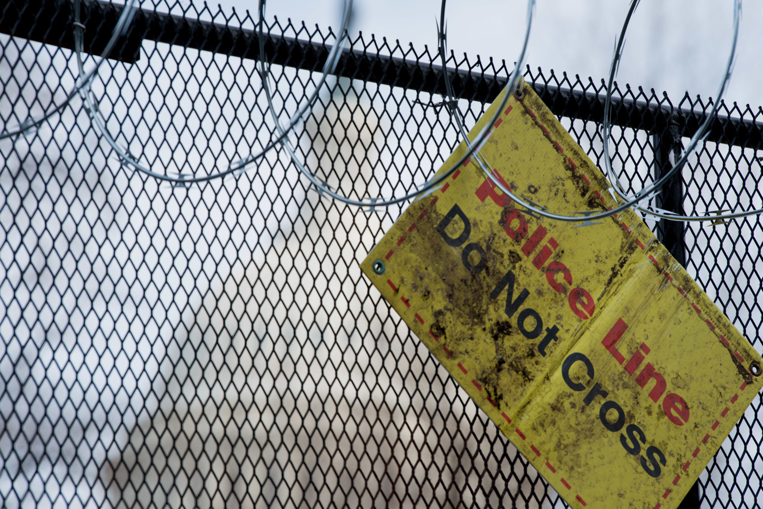 WASHINGTON, DC - JANUARY 15: A Police sign hangs from the new fencing with razor wire after last week's Riot at US Capitol and ahead of the inauguration on January 15, 2021 in Washington, DC. The FBI has warned of additional threats against the US Capitol and in all 50 states. (Photo by Liz Lynch/Getty Images)