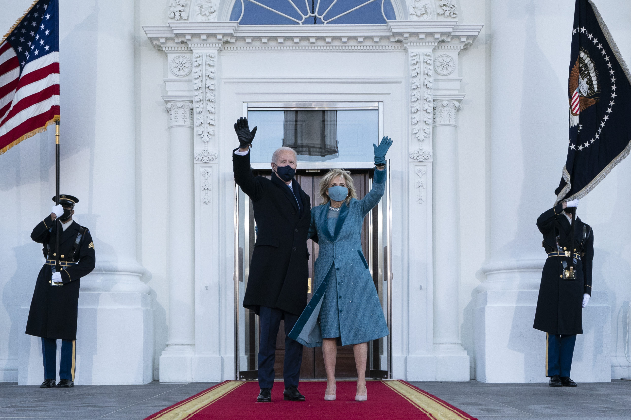 President Joe Biden and first lady Dr. Jill Biden wave as they arrive at the North Portico of the White House, on January 20, 2021, in Washington, DC. (Alex Brandon-Pool/Getty Images)