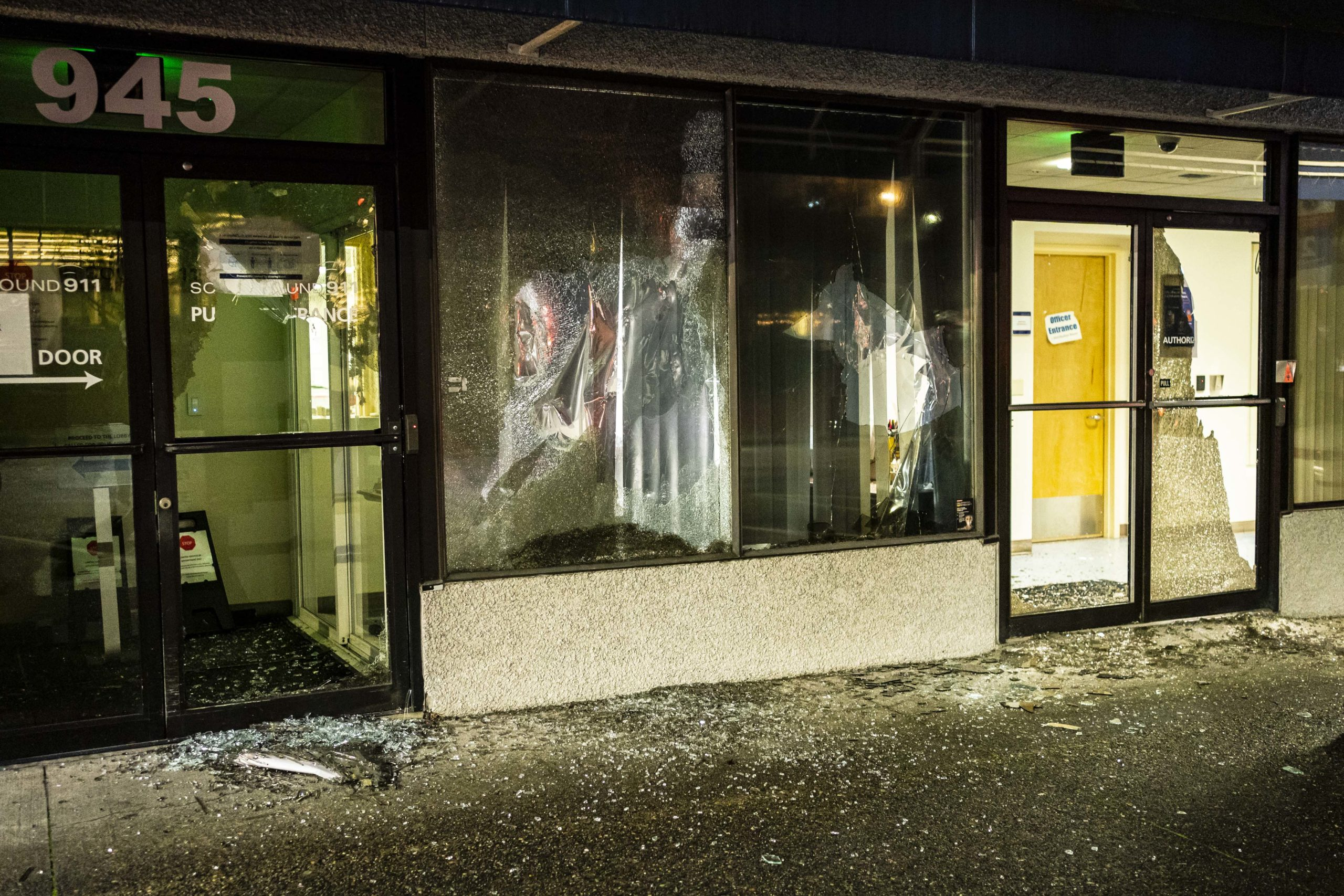 TACOMA, WA - JANUARY 24: Broken windows are seen at South Sound 911 during an anti-police protest on January 24, 2021 in Tacoma, Washington. The previous day, a Tacoma police officer drove through a crowd, spurring outrage and triggering an investigation. (Photo by David Ryder/Getty Images)