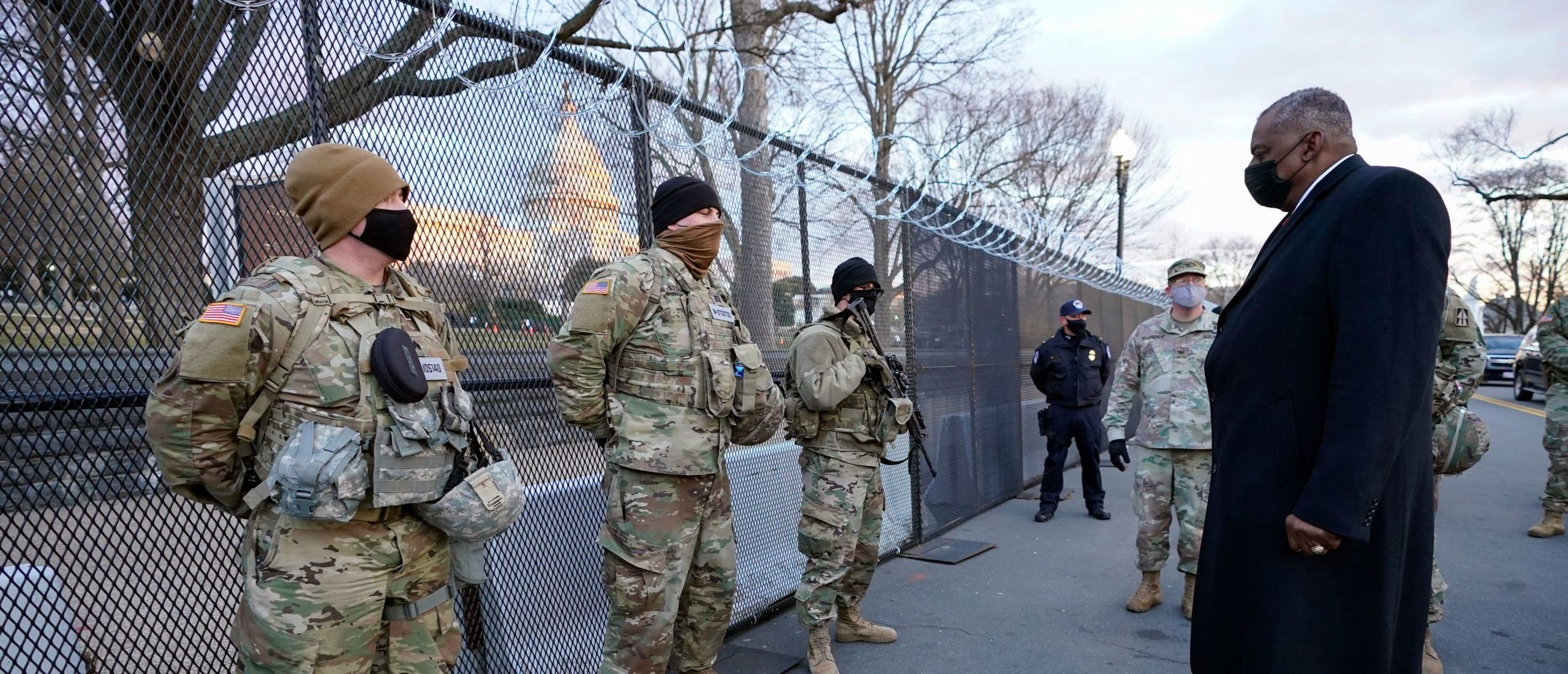 Secretary of Defense Lloyd Austin (L) visits National Guard troops deployed at the US Capitol and its perimeter, on January 29, 2021 on Capitol Hill in Washington, DC. (Photo by Manuel Balce Ceneta/AFP via Getty Images)
