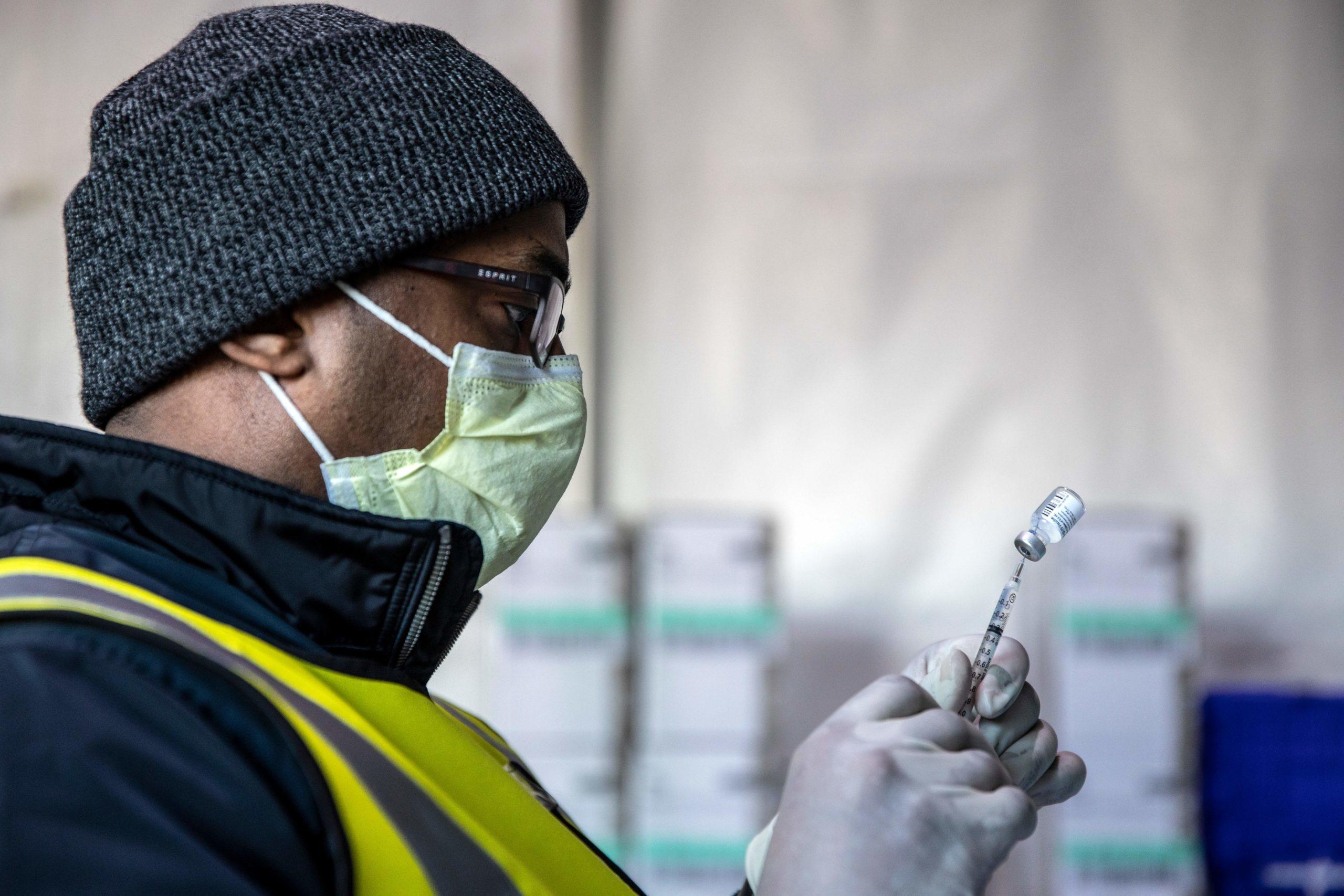 Workers prepare coronavirus vaccines at Coors Field on Saturday in Denver, Colorado. (Chet Strange/AFP via Getty Images)