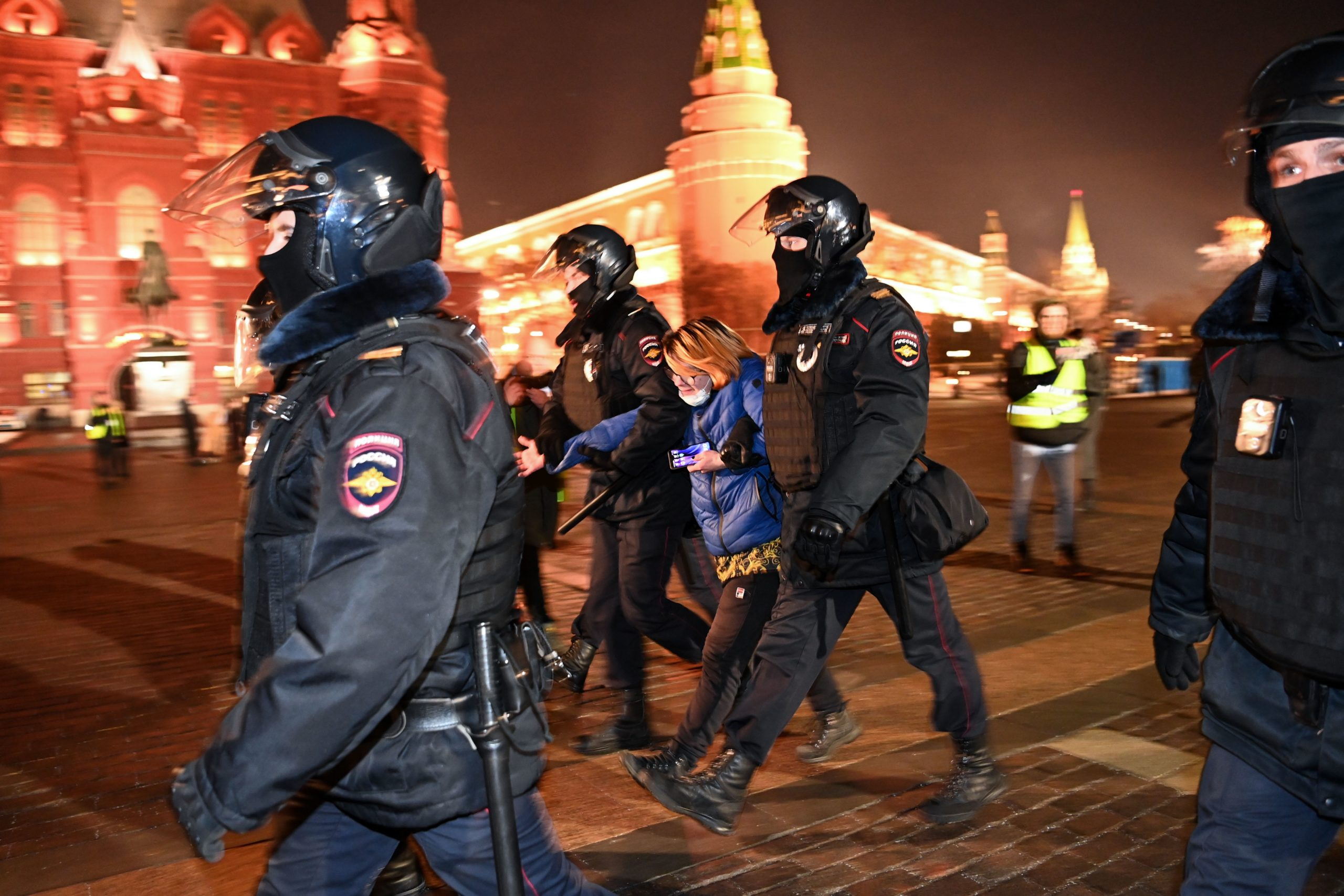 Police officers detain a woman at Moscow's Manezhnaya Square on February 2, 2021. - A Moscow court on February 2 granted a prosecutors' request for Kremlin critic Alexei Navalny to serve prison time for violating the terms of his parole. Judge Natalya Repnikova ordered a suspended three-and-a-half-year sentence Navalny received in 2014 to be changed to time in a penal colony, an AFP journalist at the courthouse said. Repnikova said time Navalny previously spent under house arrest in the sentence would count as time served, and, according to his team, that would mean at least two-and-a-half years in prison now. Navalny's Anti-Corruption Fund (FBK) immediately called for supporters to protest in central Moscow. (Photo by Kirill KUDRYAVTSEV / AFP) (Photo by KIRILL KUDRYAVTSEV/AFP via Getty Images)