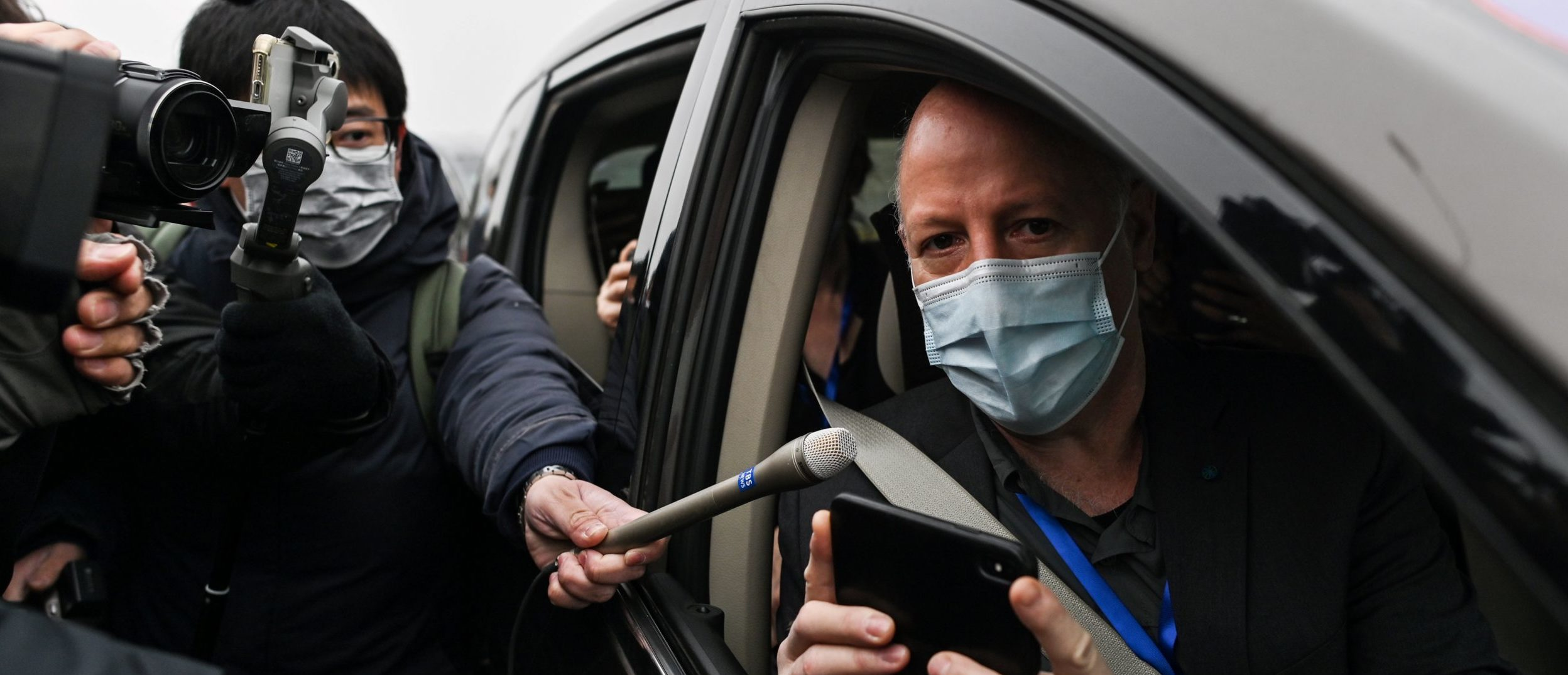 Peter Daszak, a member of the World Health Organization (WHO) team investigating the origins of the COVID-19 coronavirus, speaks to media upon arriving with other WHO members to the Wuhan Institute of Virology in Wuhan in China's central Hubei province on February 3, 2021. (HECTOR RETAMAL/AFP via Getty Images)