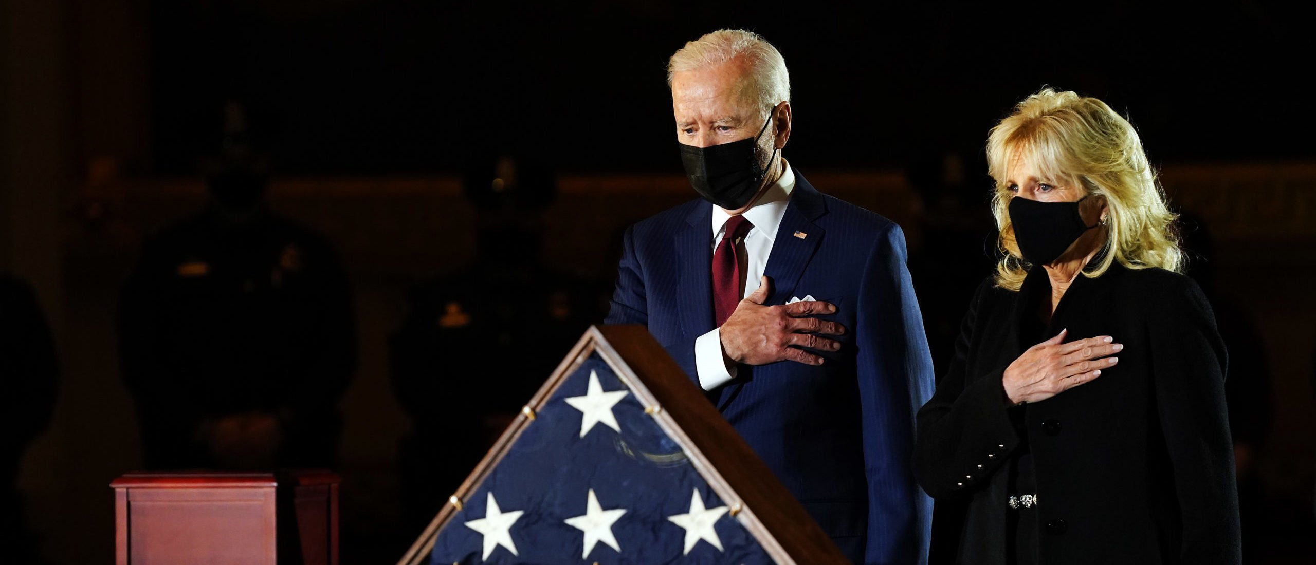 WASHINGTON, DC - FEBRUARY 02: President Joe Biden and first lady Dr. Jill Biden pay their respects to U.S. Capitol officer Brian D. Sicknick as he lies in honor in the U.S. Capitol on February 2, 2021 in Washington, DC. Officer Sicknick died as a result of injuries he sustained during the January 6 attack on the U.S. Capitol. He will lie in honor until February 3 and then be buried at Arlington National Cemetery. (Photo by Erin Schaff-Pool/Getty Images)