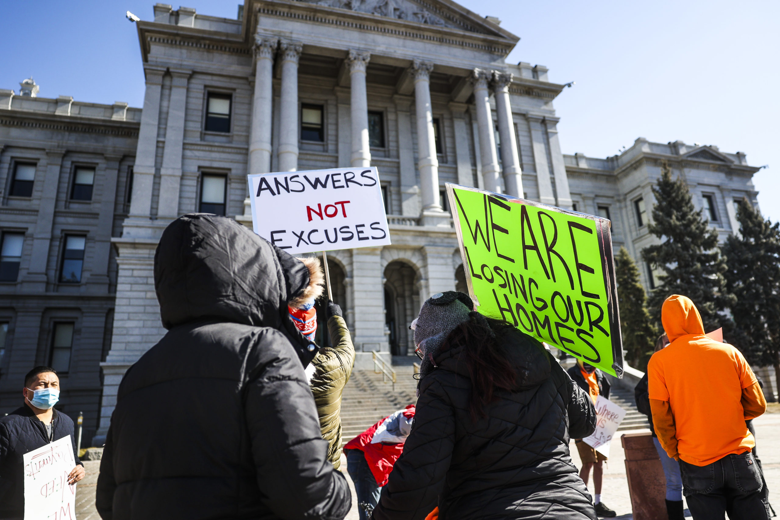 People demonstrate outside the Colorado State Capitol demanding answers about a lack of financial relief from the state on Feb. 8 in Denver, Colorado. (Michael Ciaglo/Getty Images)