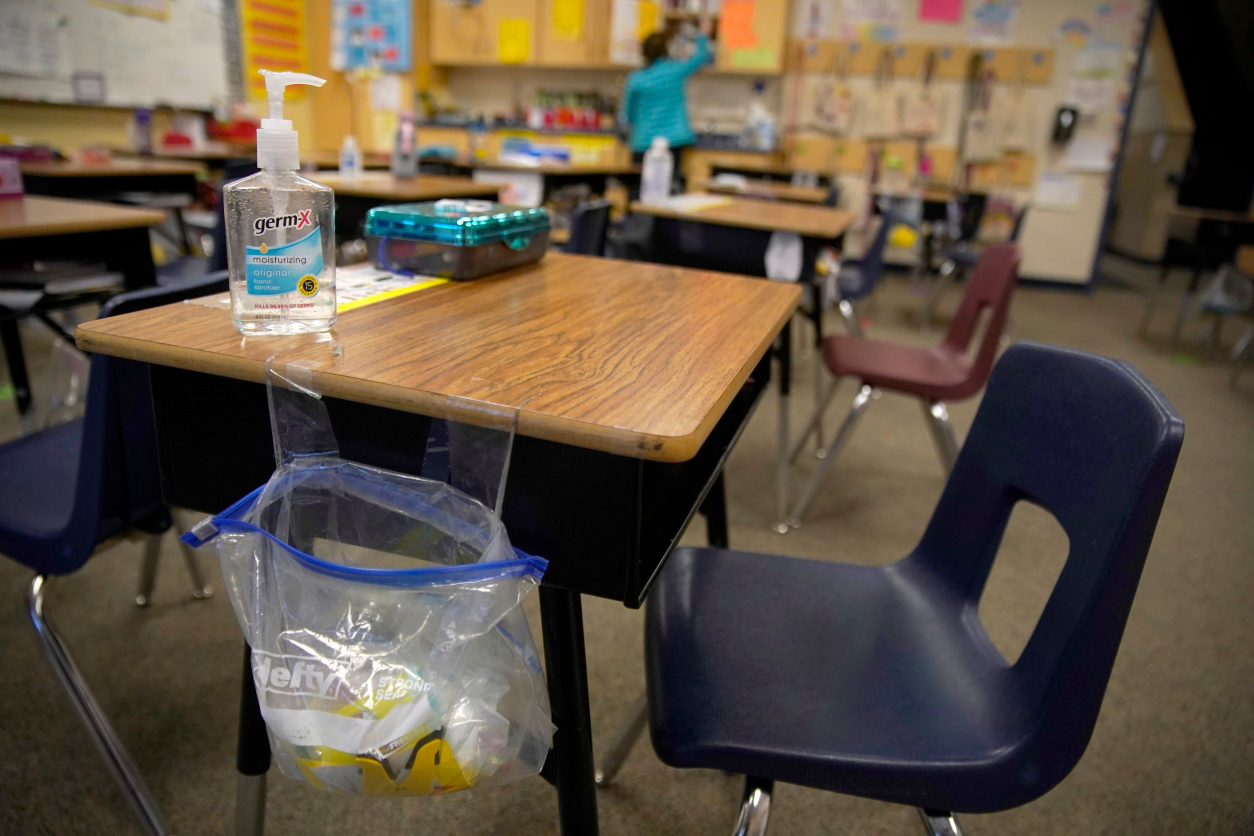 PROVO, UT - FEBRUARY 10: A teacher prepares her classroom before students arrive for school at Freedom Preparatory Academy on February 10, 2021 in Provo, Utah. Freedom Academy has done in person instruction since the middle of August of 2020 with only four days of school canceled due to COVID-19 outbreak. (Photo by George Frey/Getty Images)