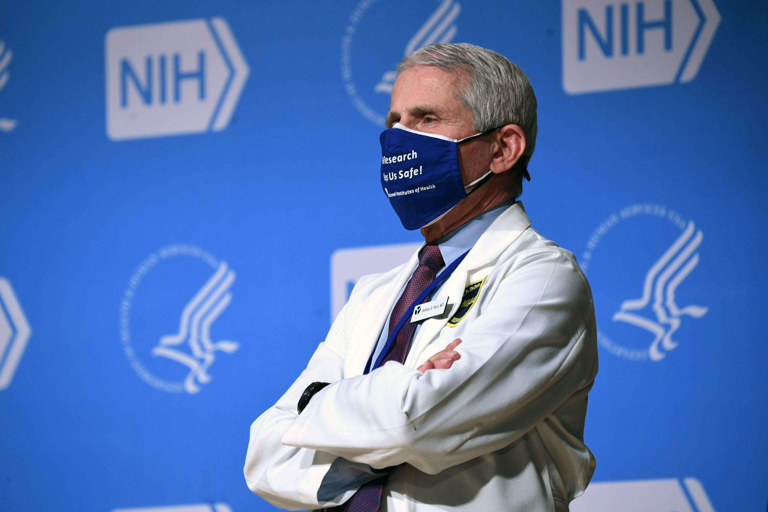 White House Chief Medical Adviser on Covid-19 Dr. Anthony Fauci listens to US President Joe Biden (out of frame) speak during a visit to the National Institutes of Health (NIH) in Bethesda, Maryland, February 11, 2021. (Photo by SAUL LOEB/AFP via Getty Images)