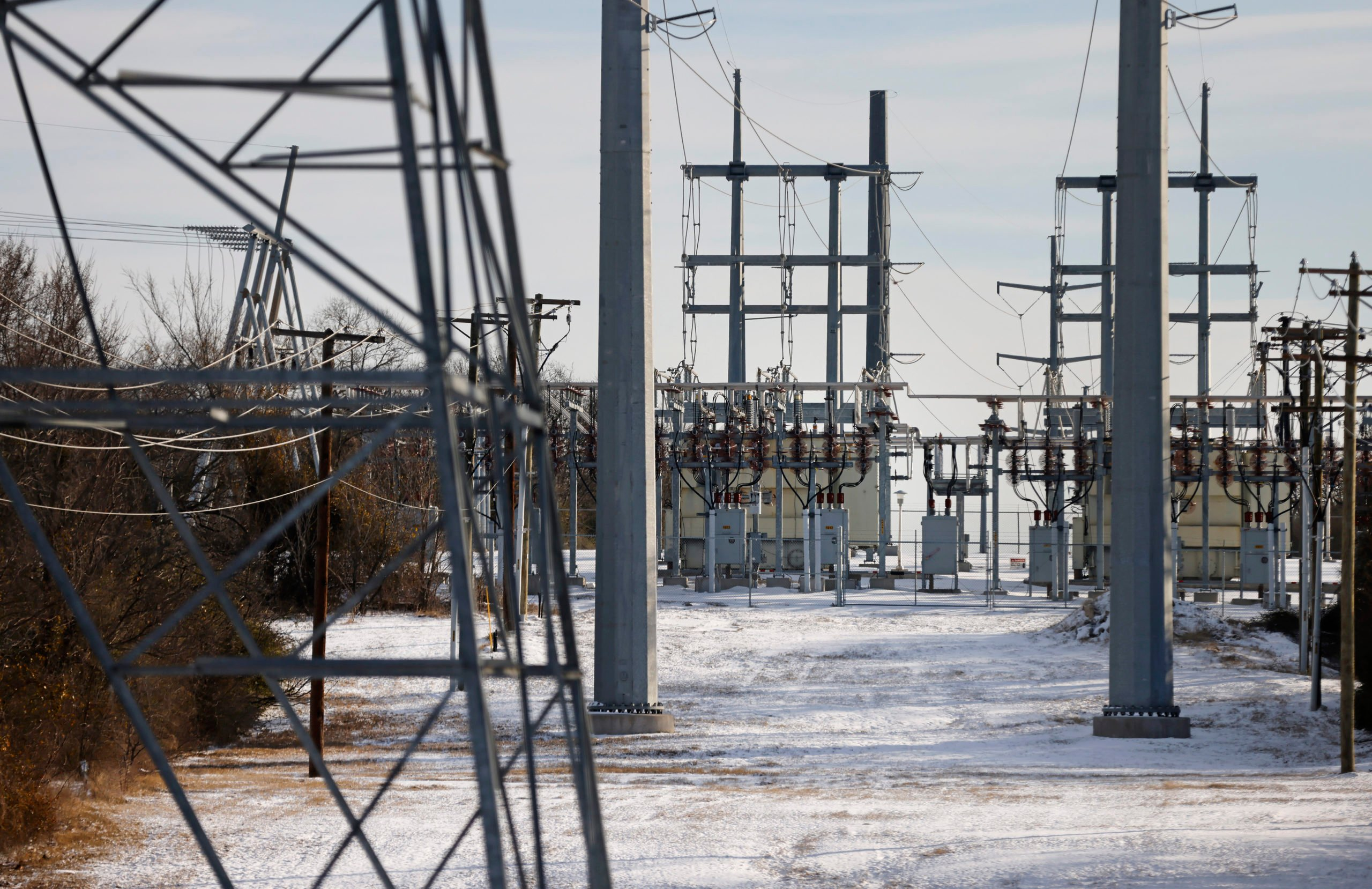 FORT WORTH, TX - FEBRUARY 16: Transmission towers and power lines lead to a substation after a snow storm on February 16, 2021 in Fort Worth, Texas. Winter storm Uri has brought historic cold weather and power outages to Texas as storms have swept across 26 states with a mix of freezing temperatures and precipitation. (Photo by Ron Jenkins/Getty Images)
