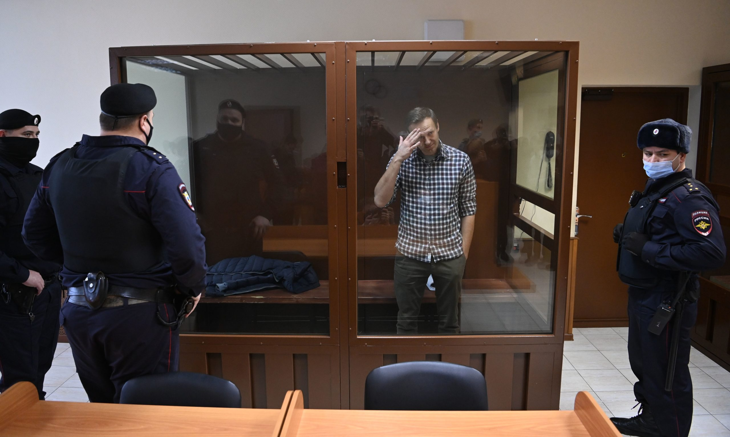 Russian opposition leader Alexei Navalny stands inside a glass cell during his court hearing Saturday. (Kirill Kudryavtsev/AFP via Getty Images)