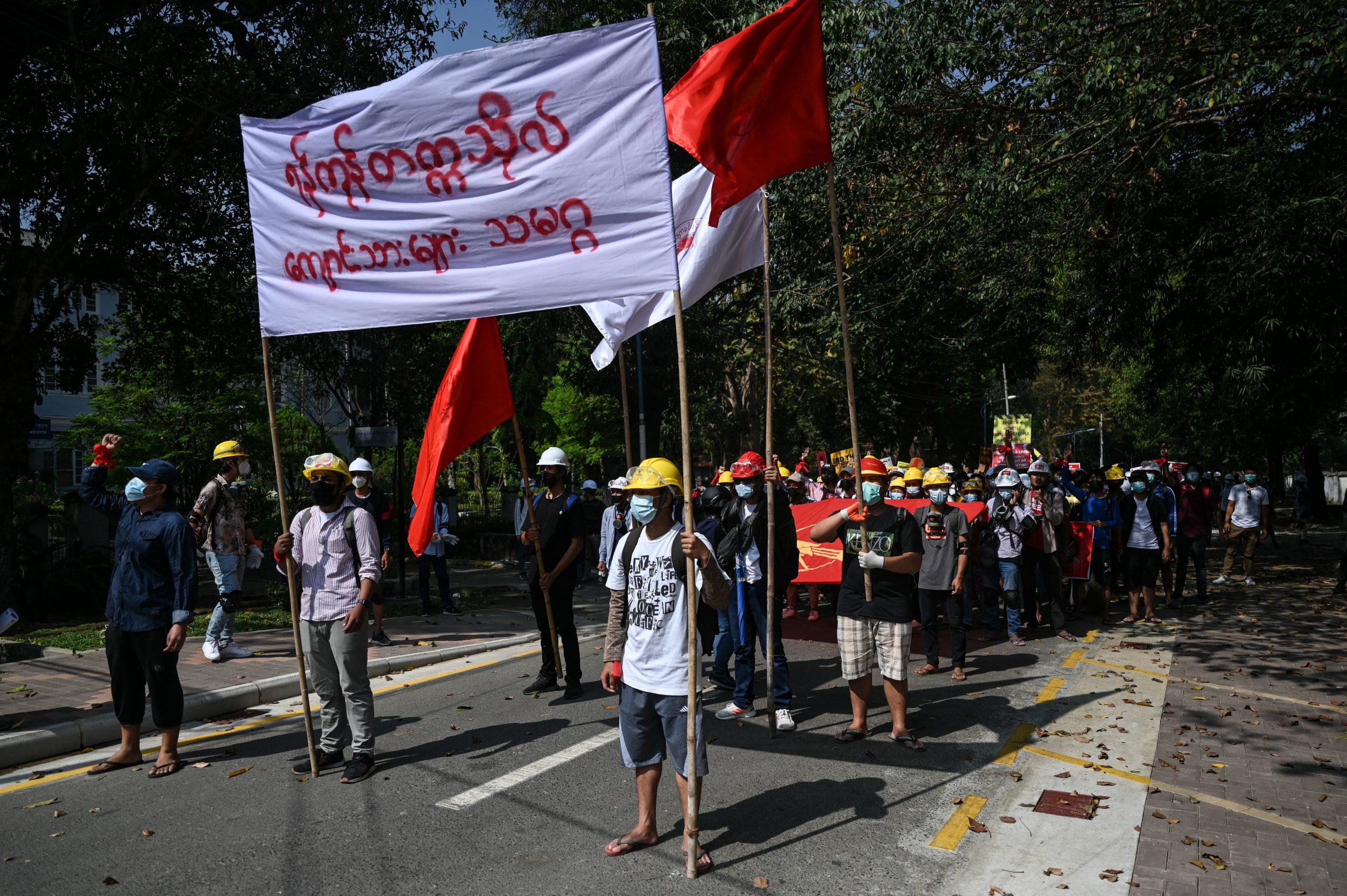 Students protest in the Yangon University compound against the military coup in Yangon on February 25, 2021. (YE AUNG THU/AFP via Getty Images)