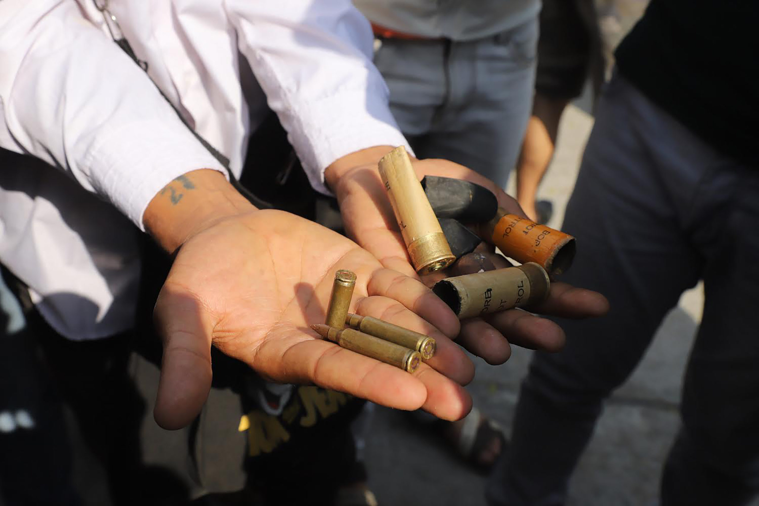 EDITORS NOTE: Graphic content / A protester holds bullet cartridges and ammunition for slingshots after security forces fired on demonstrators at a rally against the military coup in Mandalay on February 26, 2021. (Photo by STR / AFP) (Photo by STR/AFP via Getty Images)