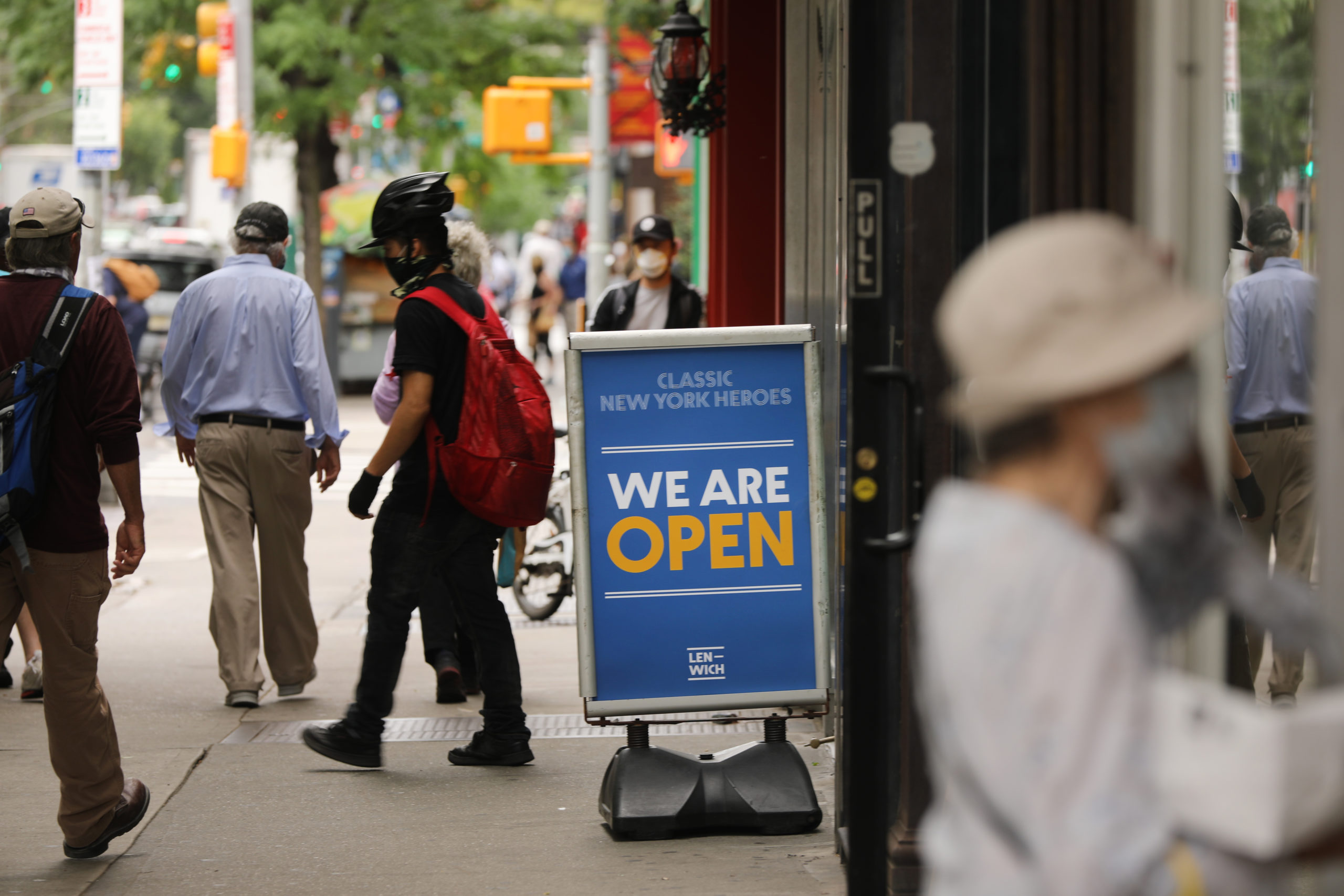 People walk on the streets of New York City in June as businesses reopen. (Spencer Platt/Getty Images)