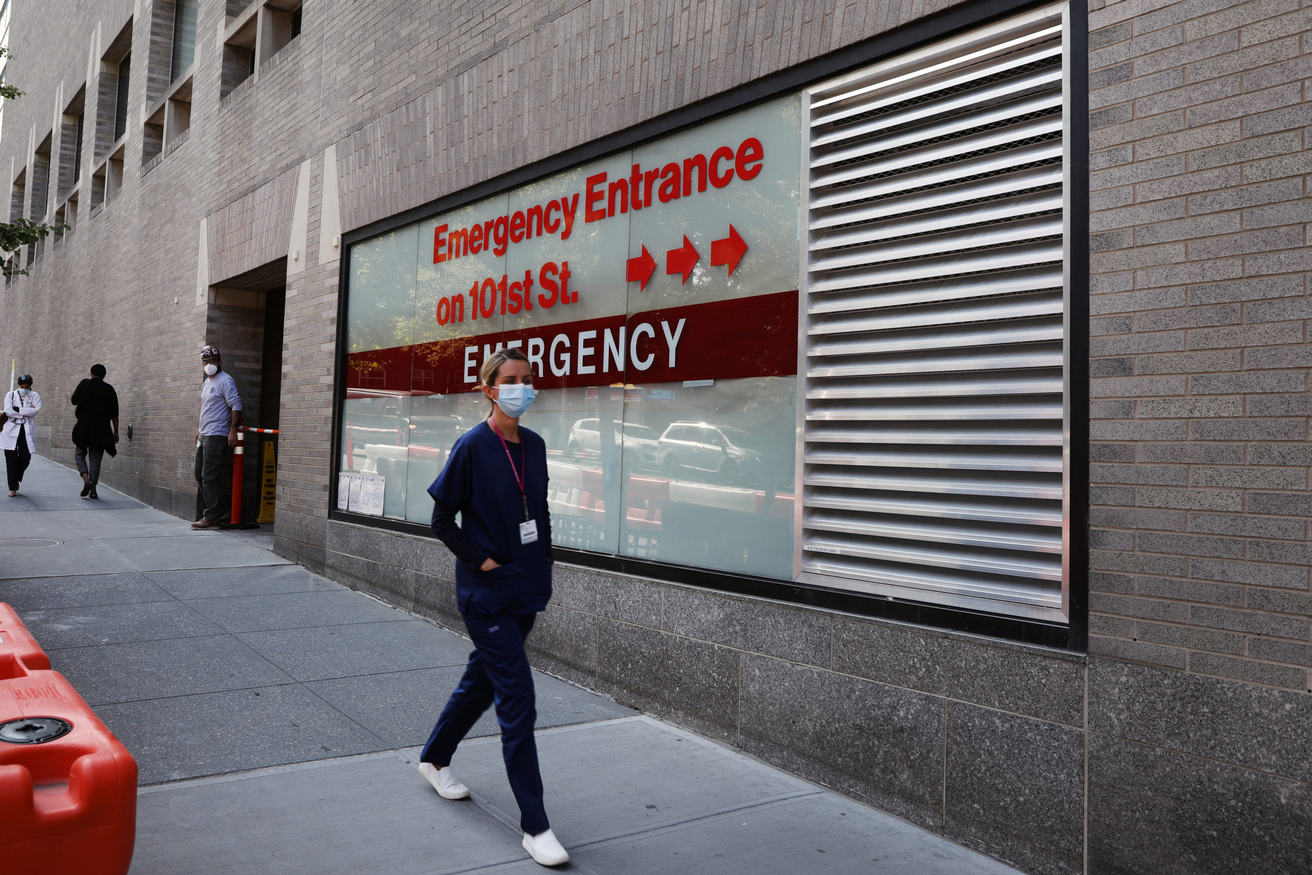"""NEW YORK, NEW YORK - SEPTEMBER 22: A person walks past an """"Emergency Entrance"""" sign at Mount Sinai Hospital in Manhattan, which has treated hundreds of COVID-19 patients since March, on September 22, 2020 in New York City. While New York's infection rate is currently below one percent, the U.S. has reported more than 6.7 million confirmed cases and 200,000 deaths attributed to COVID-19, making it the world leader in both. (Photo by Spencer Platt/Getty Images)"""