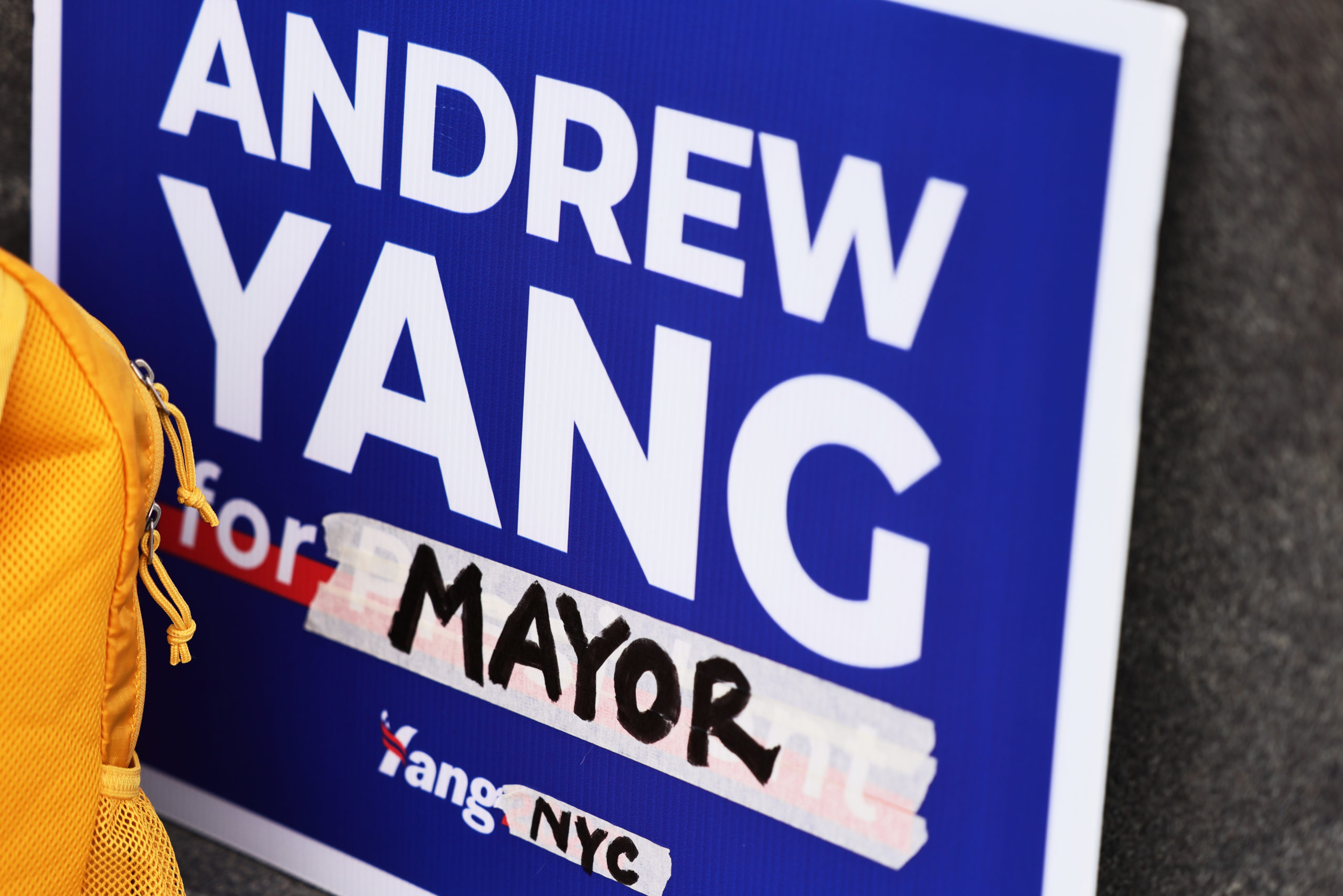 A former Andrew Yang presidential campaign sign is adjusted for his New York City mayoral campaign on Jan. 14. (Michael M. Santiago/Getty Images)
