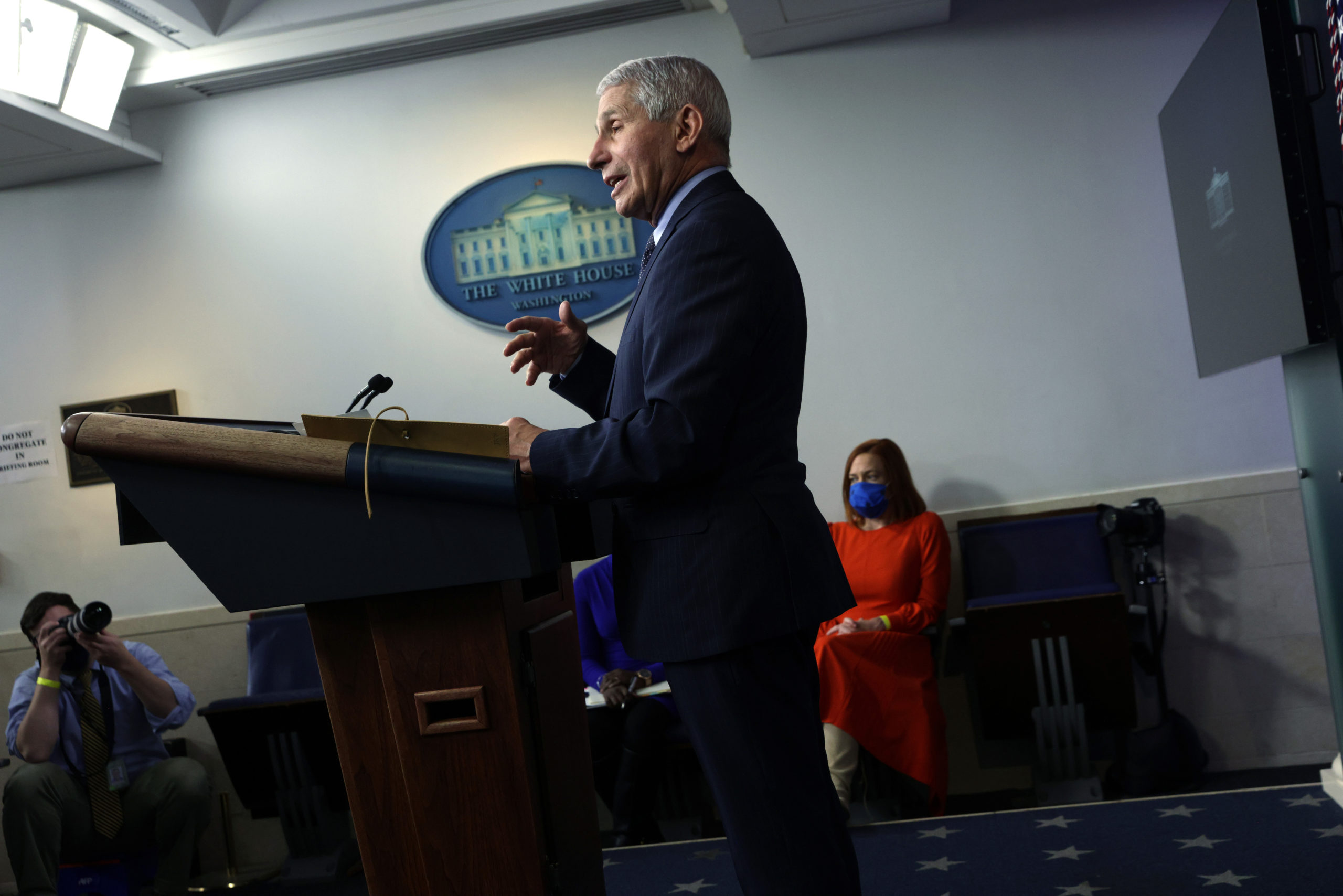 WASHINGTON, DC - JANUARY 21: Director of the National Institute of Allergy and Infectious Diseases Dr Anthony Fauci speaks as White House Press Secretary Jen Psaki listens during a White House press briefing at the James Brady Press Briefing Room of the White House January 21, 2021 in Washington, DC. Psaki held her second press briefing since President Joe Biden took office yesterday. (Photo by Alex Wong/Getty Images)