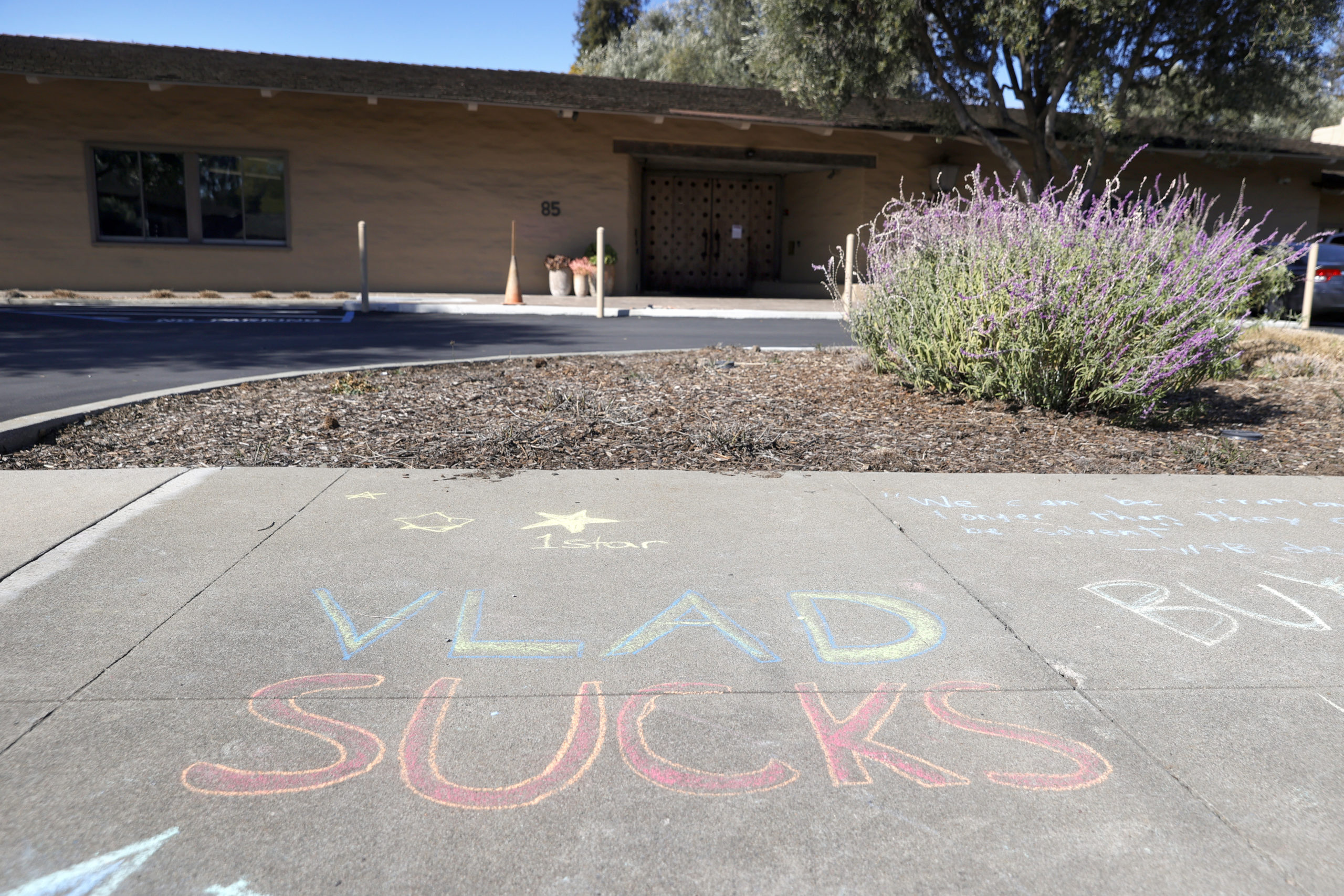 A chalk drawing referencing Vladimir Tenev, the co-founder of trading app Robinhood, is visible on the sidewalk in front of the company's headquarters on Monday in Menlo Park, California. (Justin Sullivan/Getty Images)