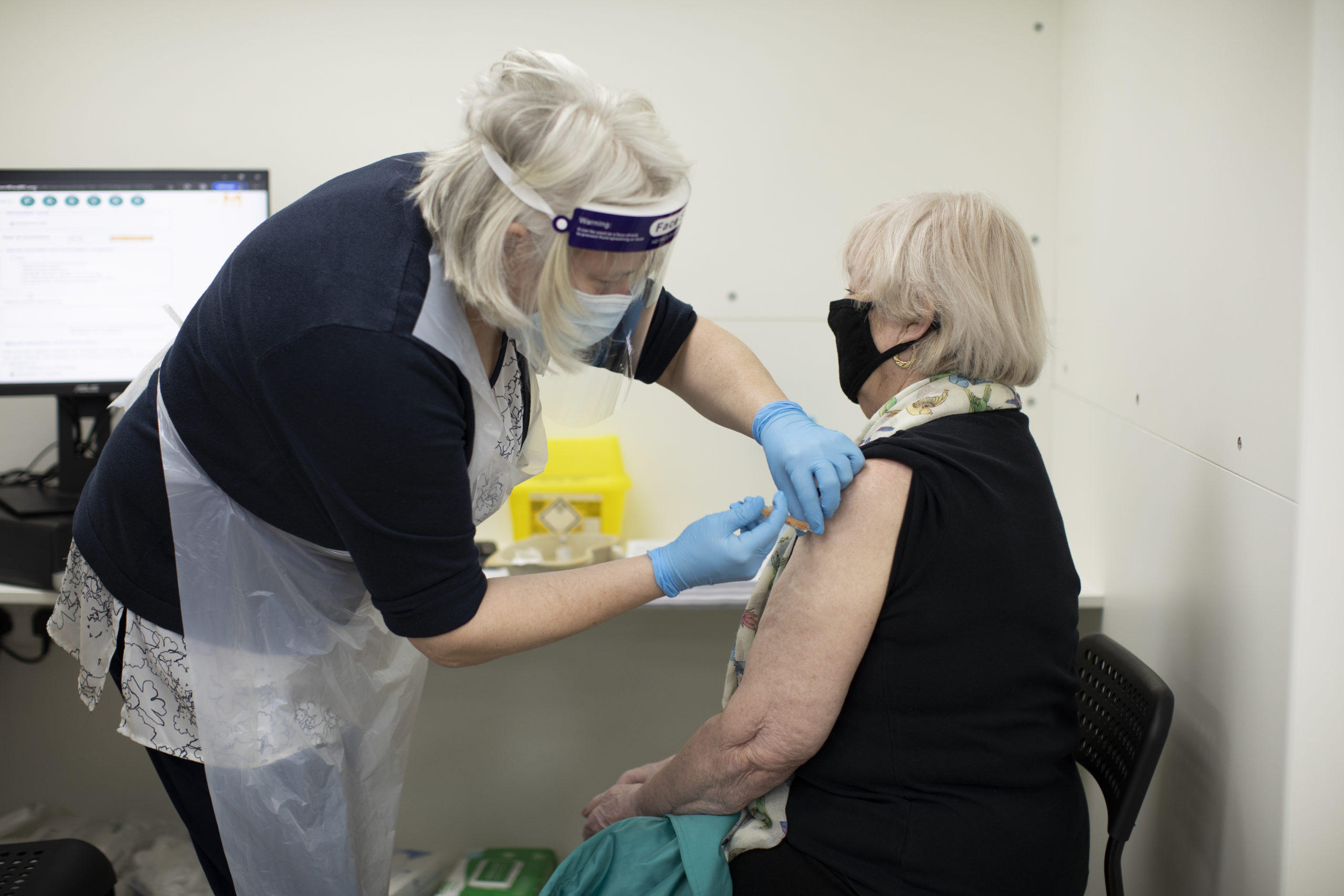 Patients receive the AstraZeneca COVID-19 vaccine at Copes pharmacy in Streatham on February 04, 2021 in London, England. (Dan Kitwood/Getty Images)