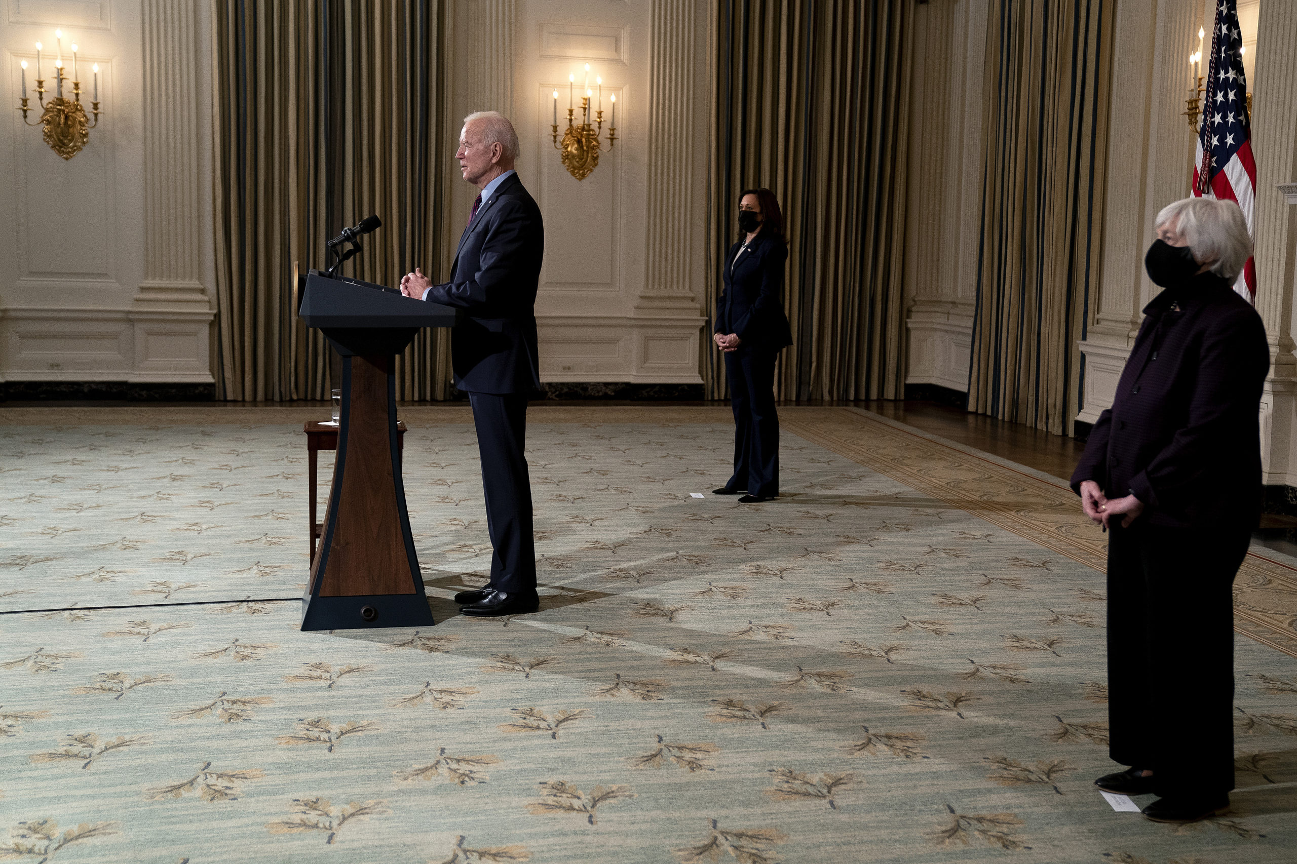 President Joe Biden delivers remarks on the economy with Vice President Kamala Harris and Treasury Sec. Janet Yellen on Friday. (Stefani Reynolds/Pool/Getty Images)