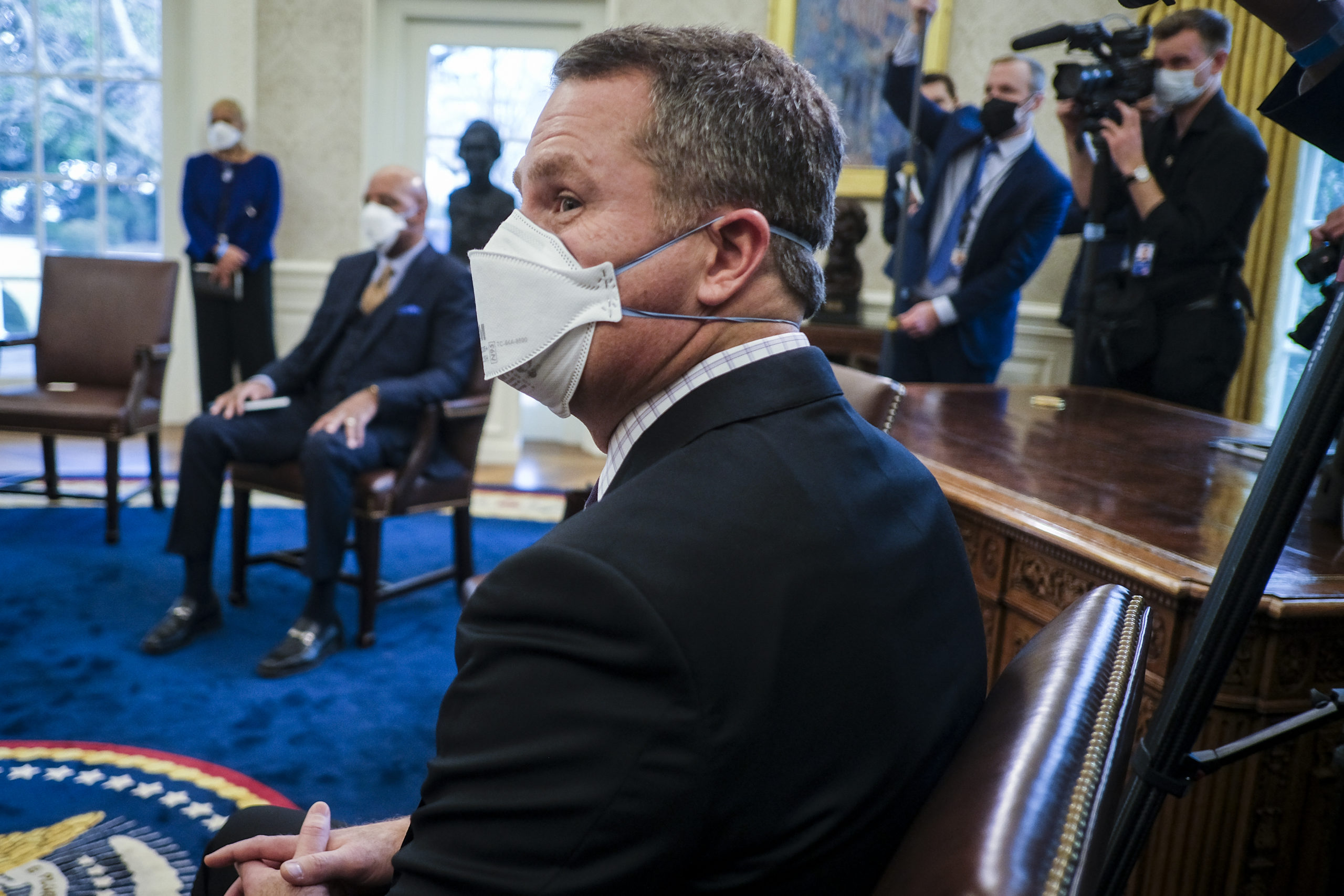 Doug McMillon, president and CEO of Walmart, listens during a meeting with President Joe Biden in the Oval Office on Feb. 9. (Pete Marovich/Pool/Getty Images)