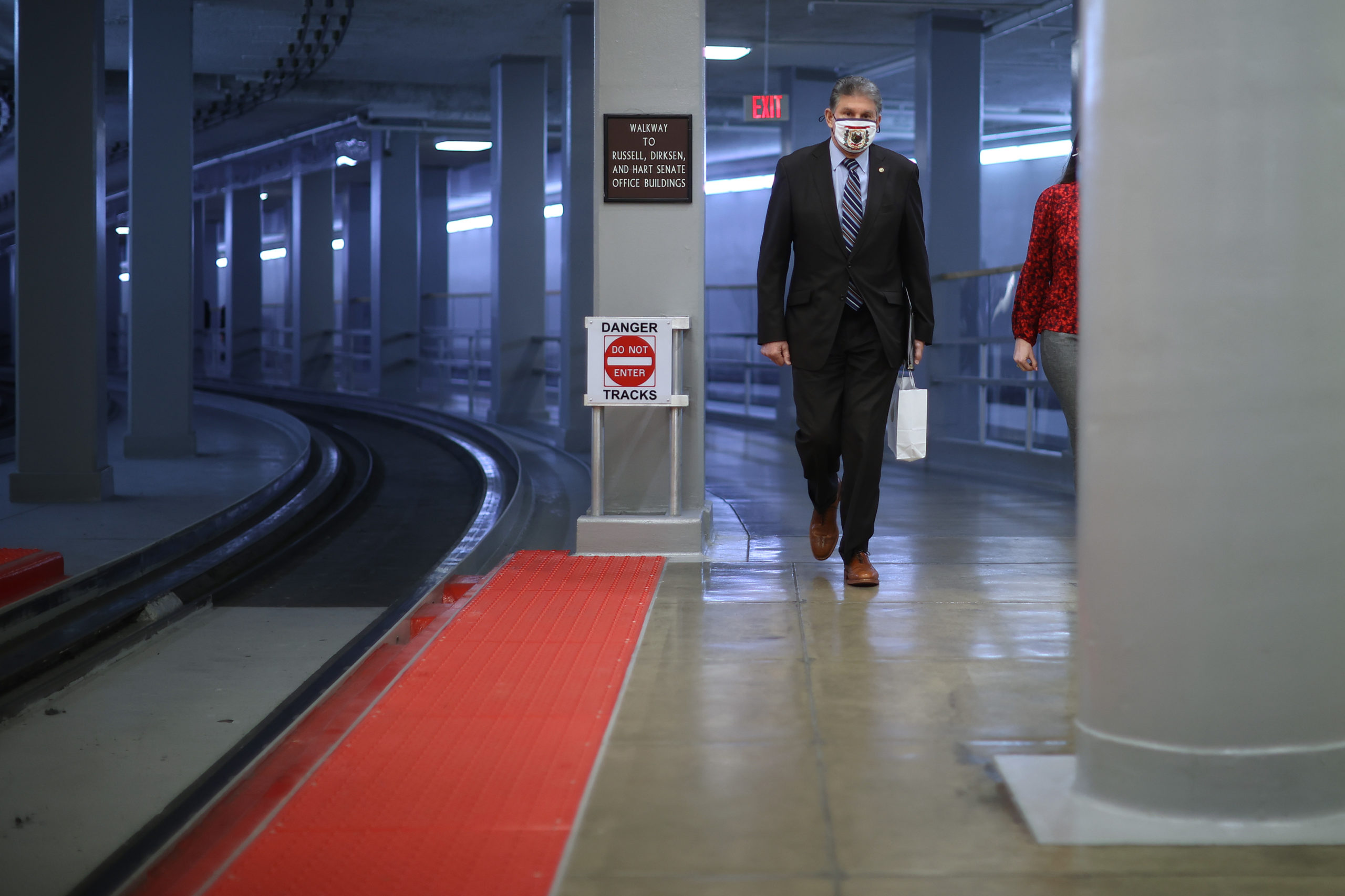 Sen. Joe Manchin walks through the subway tunnel on his way to the U.S. Capitol on the third day of former President Donald Trump's impeachment trial on February 11, 2021 in Washington, DC. (Chip Somodevilla/Getty Images)