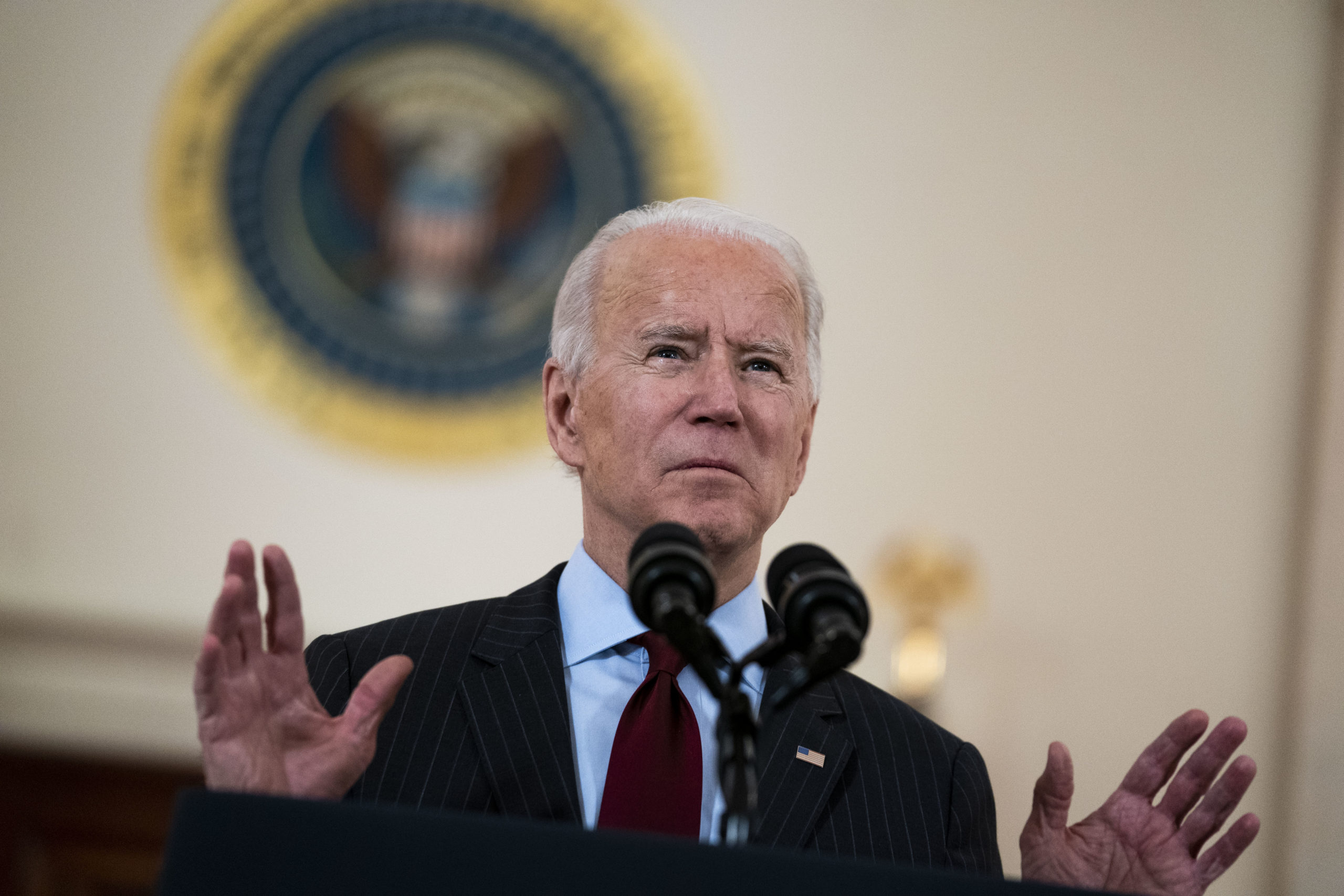 WASHINGTON, DC - FEBRUARY 22: U.S. President Joe Biden delivers remarks on the more than 500,000 lives lost to COVID-19 in the Cross Hall of the White House February 22, 2021 in Washington, DC. Also on hand for the ceremony were first lady Jill Biden, Vice President Kamala Harris and husband Doug Emhoff. (Photo by Doug Mills-Pool/Getty Images)