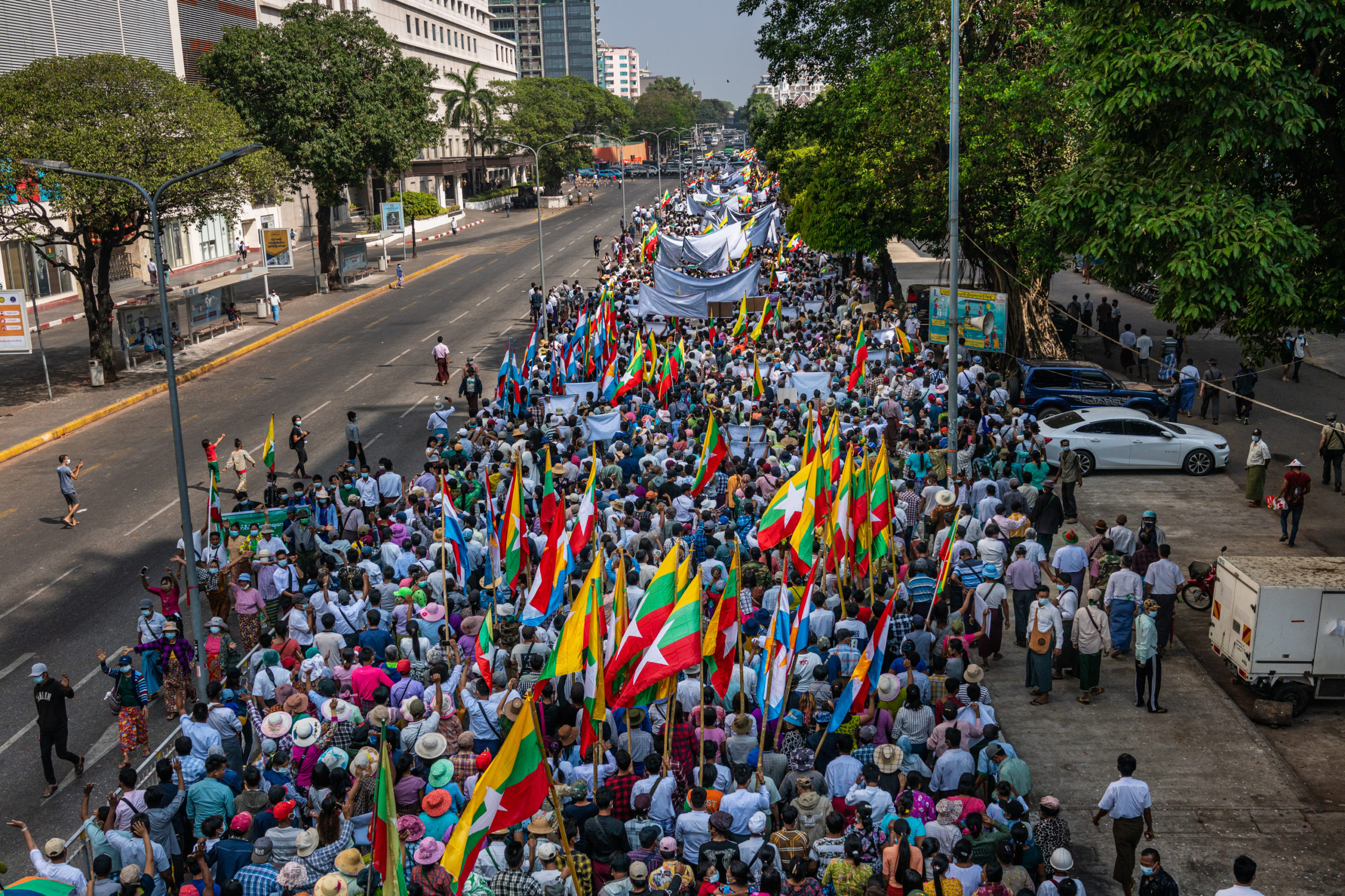 Pro-military supporters march on February 25, 2021 in Yangon, Myanmar. Supporters of the military junta that staged a coup against Aung San Suu Kyi's National League for Democracy (NLD) government marched in Yangon on Thursday. (Hkun Lat/Getty Images)