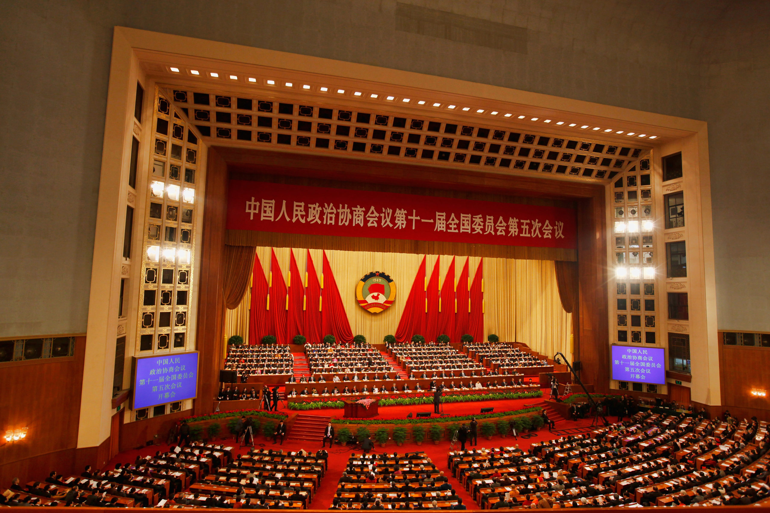 BEIJING, CHINA - MARCH 03: Delegates take their seats for the opening ceremony of the Chinese People's Political Consultative Conference (CPPCC) at Great Hall of the People on March 3, 2012 in Beijing, China. The Chinese People's Political Consultative Conference opens on March 3 in Beijing. (Photo by Lintao Zhang/Getty Images)