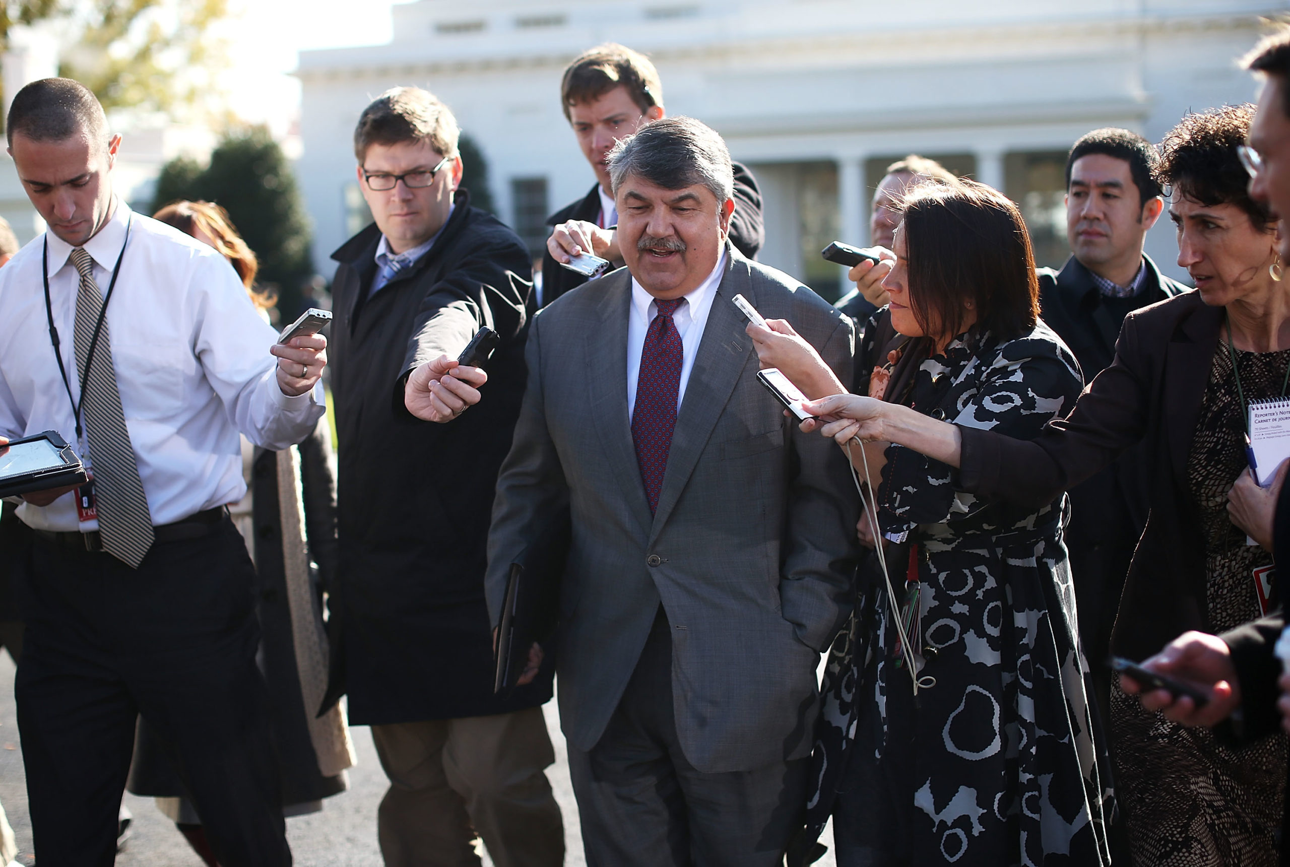 AFL-CIO President Richard Trumka and other labor leaders speak after a meeting with former President Barack Obama in 2012. (Alex Wong/Getty Images)