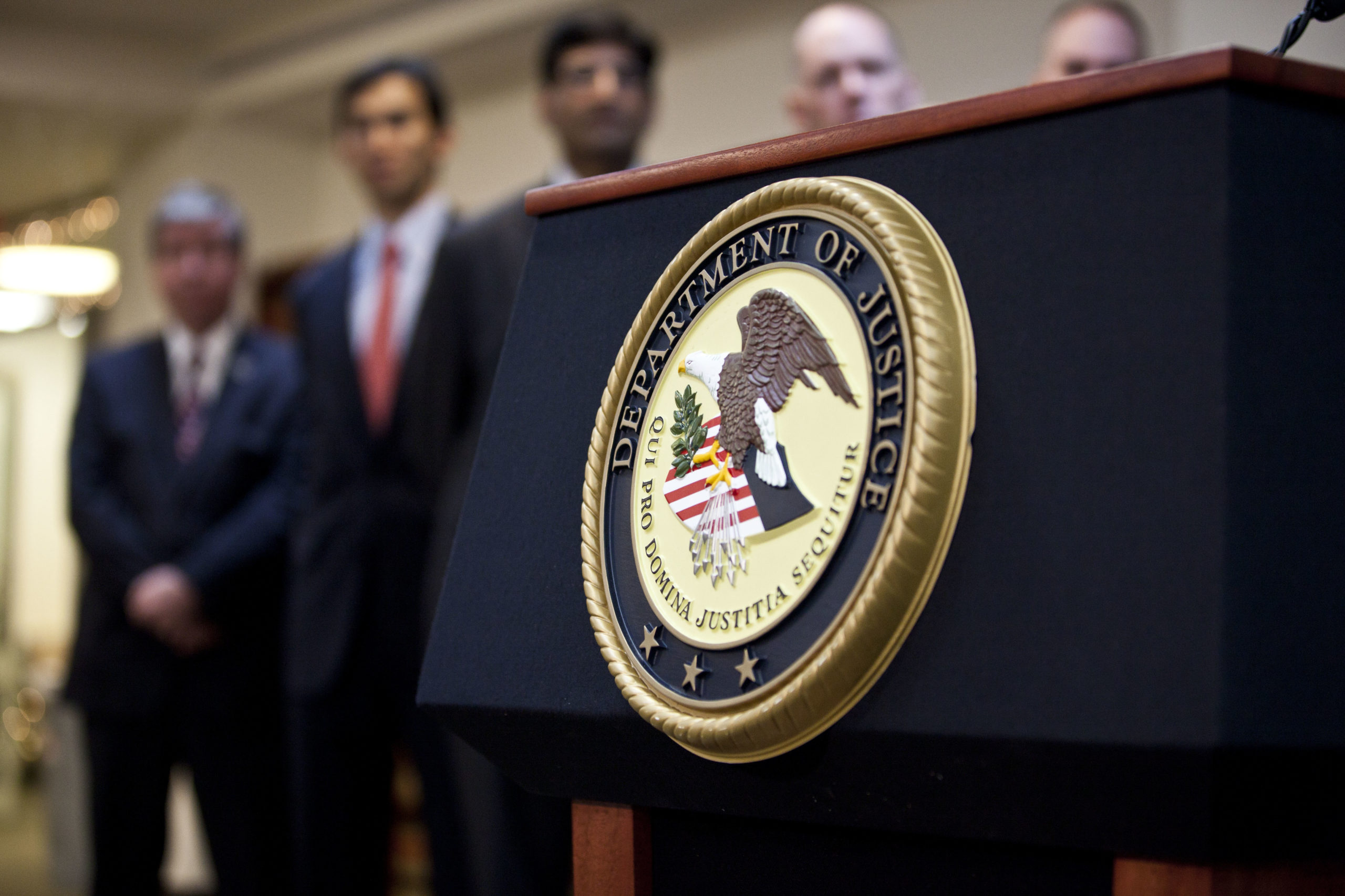 NEW YORK, NY - DECEMBER 11: A US Department of Justice seal is displayed on a podium during a news conference to announce money laundering charges against HSBC on December 11, 2012 in the Brooklyn borough of New York City. HSBC Holdings plc and HSBC USA NA have agreed to pay $1.92 billion and enter into a deferred prosecution agreement with the U.S. Department of Justice in regards to charges involving money laundering with Mexican drug cartels. (Photo by Ramin Talaie/Getty Images)