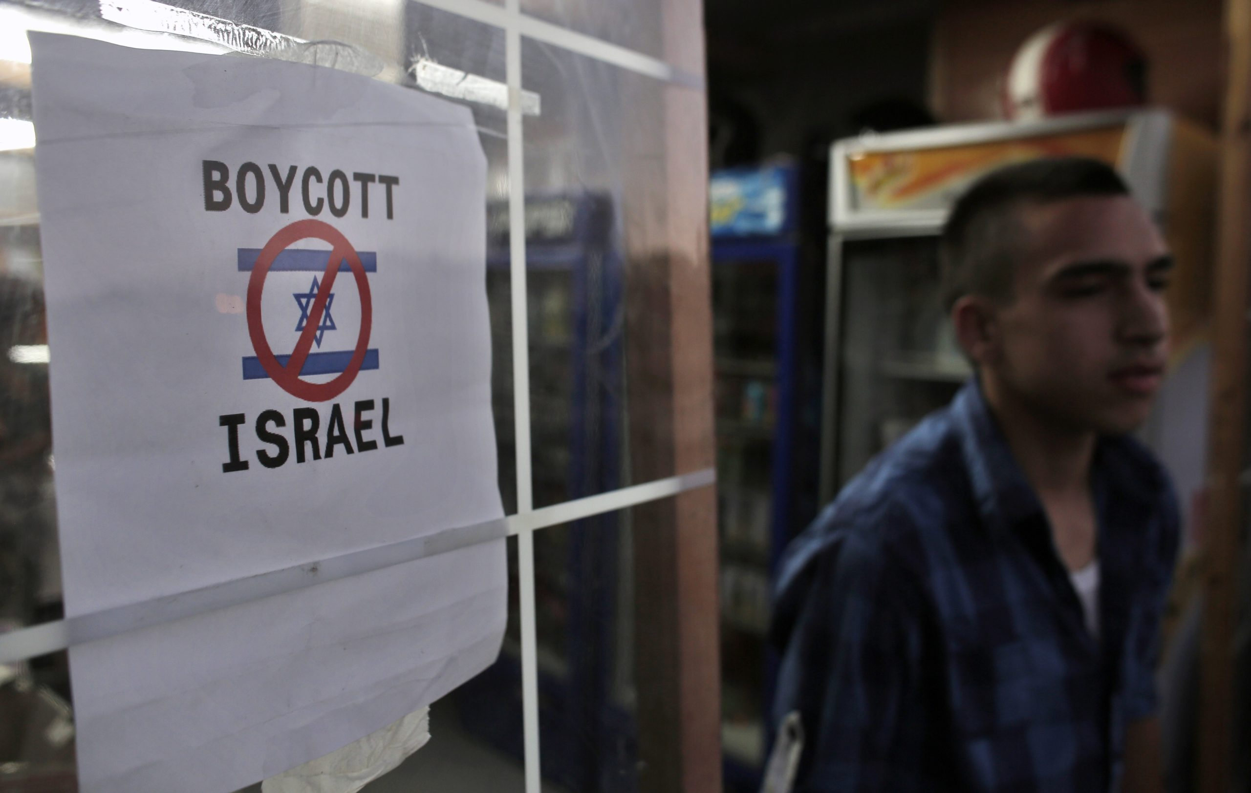 Boycott Israel sign in east Jerusalem (AHMAD GHARABLI/AFP via Getty Images)