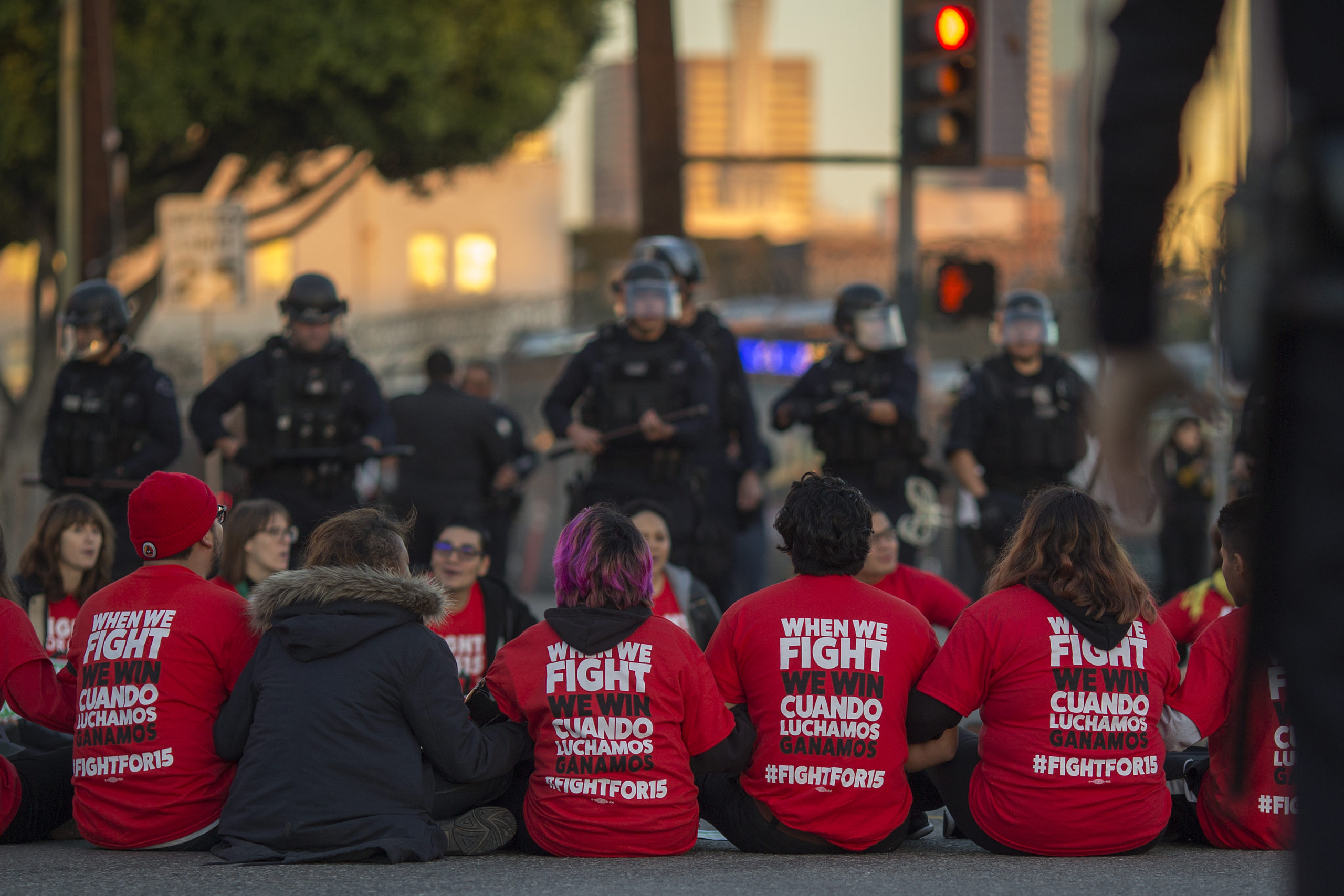 LOS ANGELES, CA - NOVEMBER 29: Police surround striking McDonald's restaurant employees sitting in an intersection after walking off the job to demand a $15 per hour wage and union rights during nationwide 'Fight for $15 Day of Disruption' protests on November 29, 2016 in Los Angeles, California. Police made 40 peaceful arrests. Protest rallies are expected in nearly 20 airports and outside restaurants in numerous cities, according to organizers. (Photo by David McNew/Getty Images)