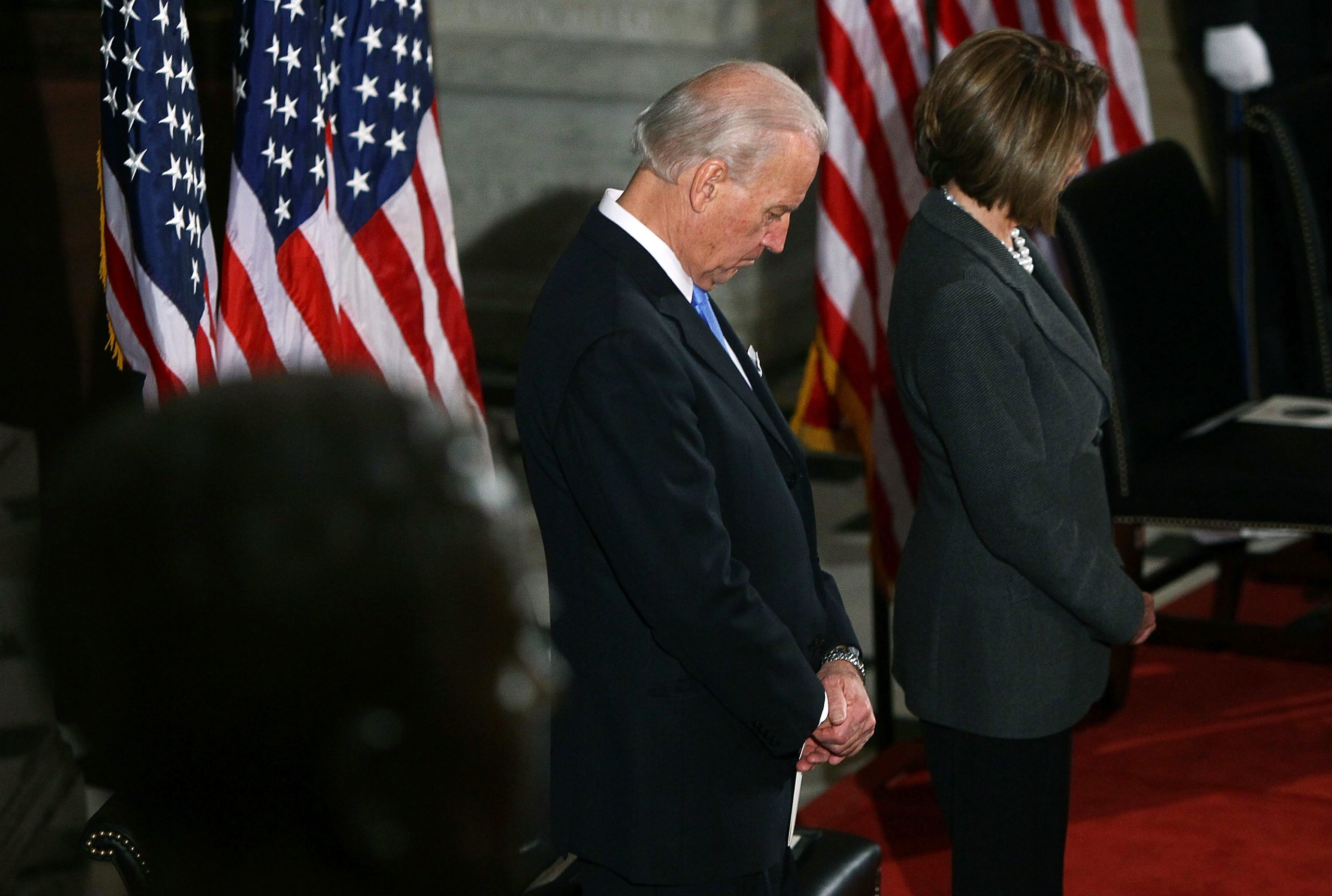 U.S. Vice President Joe Biden and Speaker of the House Nancy Pelosi bow their heads in prayer at a memorial service for Rep. John Murtha at the U.S. Capitol March 3, 2010 in Washington, DC. (Win McNamee/Getty Images)