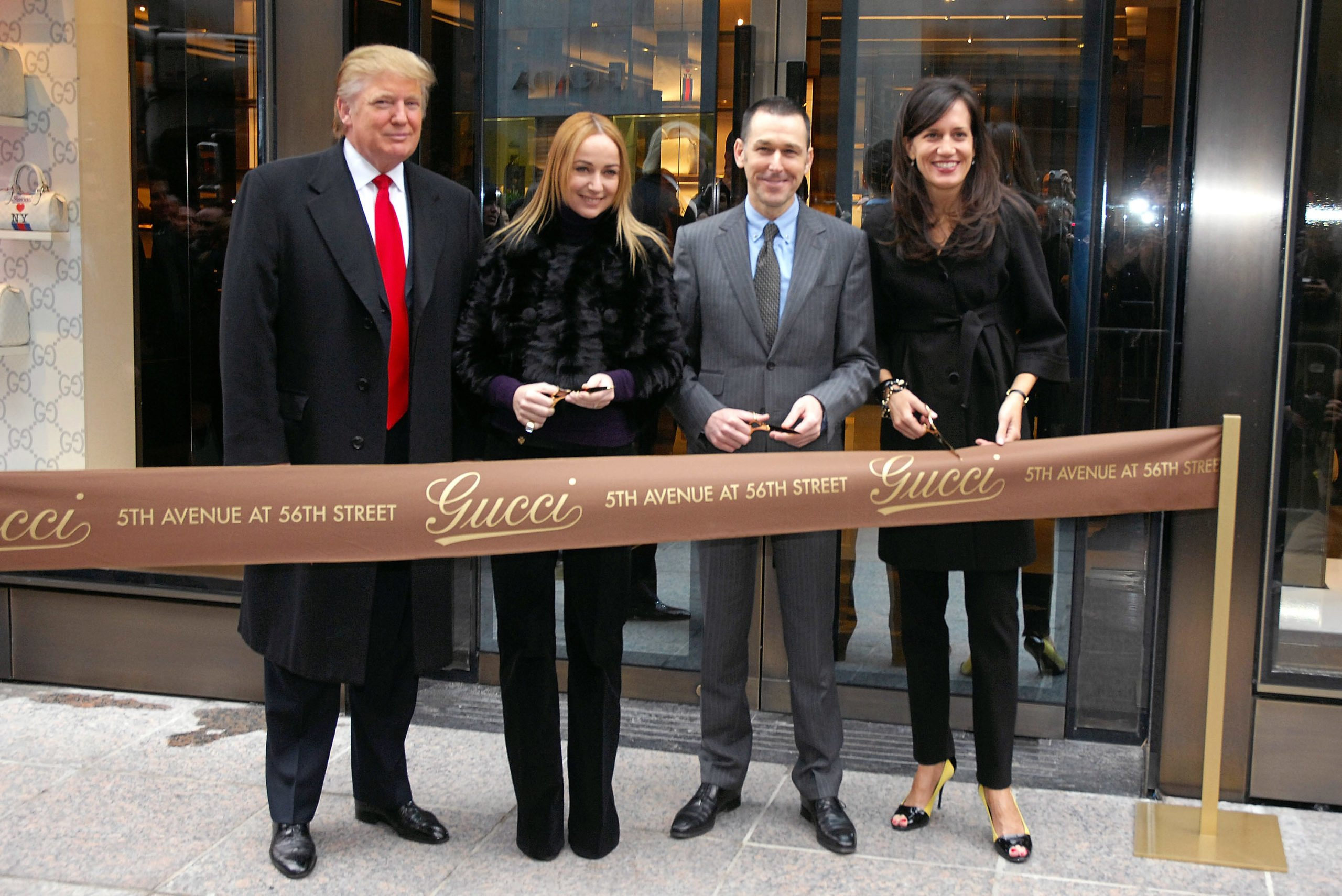 Donald Trump (L) joins Gucci Creative Director Frida Giannini, Gucci CEO Mark Lee and Gucci President Daniella Vitale for the new flagship store ribbon cutting at Trump Tower on February 8, 2008 in New York City. (Photo by Rob Loud/Getty Images)