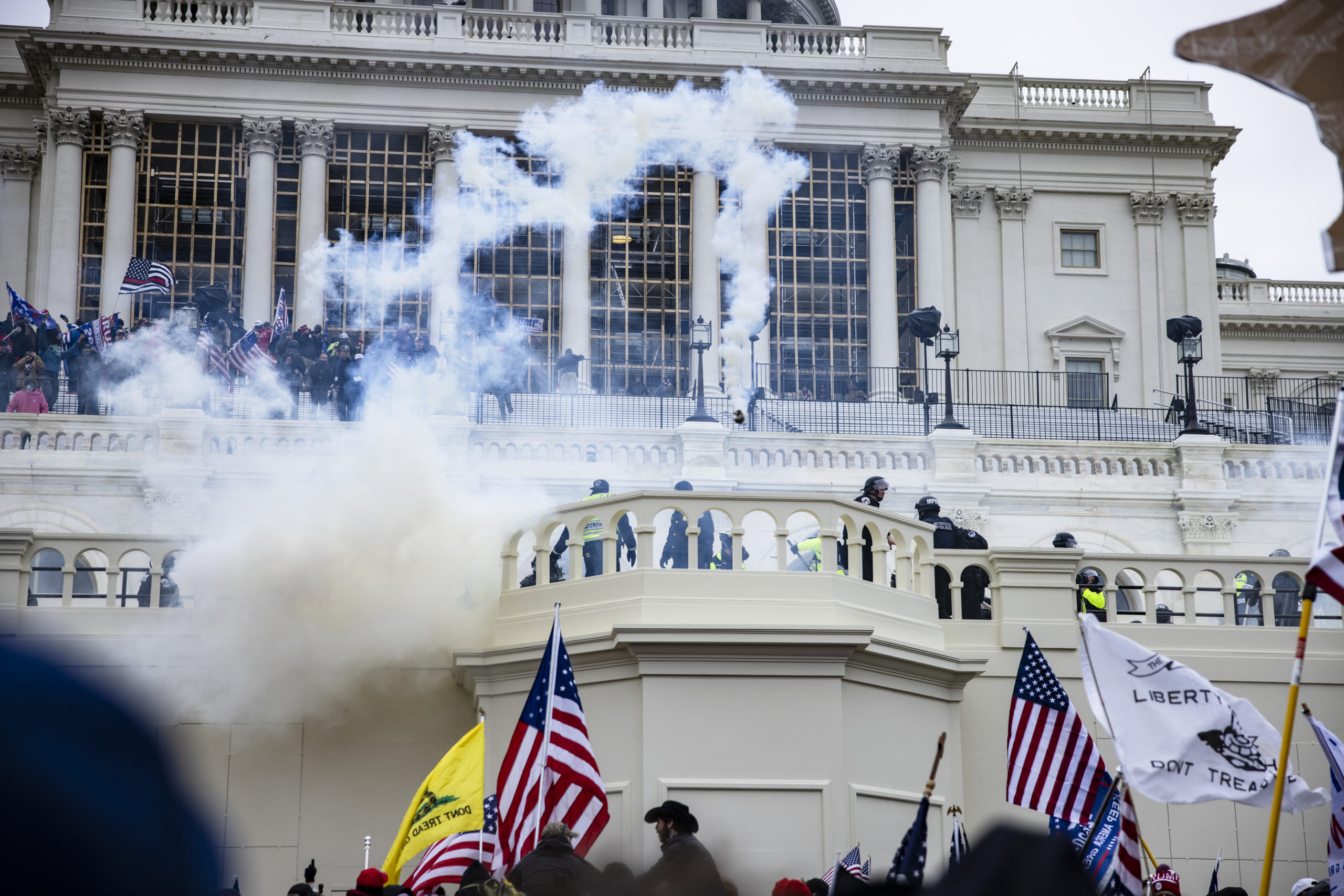 Pro-Trump supporters storm the U.S. Capitol following a rally with President Donald Trump on January 6, 2021 in Washington, DC. (Photo by Samuel Corum/Getty Images)