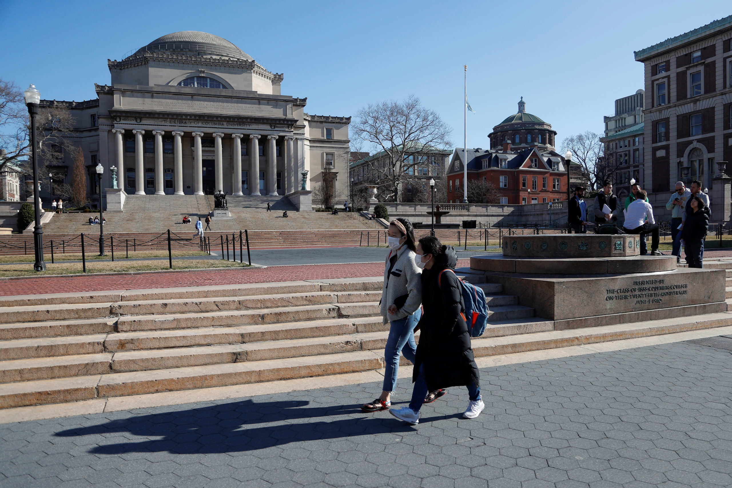 People with face masks walk at Columbia University in New York City, where classes on Monday and Tuesday were suspended because someone on the campus was under quarantine from exposure to the coronavirus, in New York, U.S., March 9, 2020. REUTERS/Shannon Stapleton