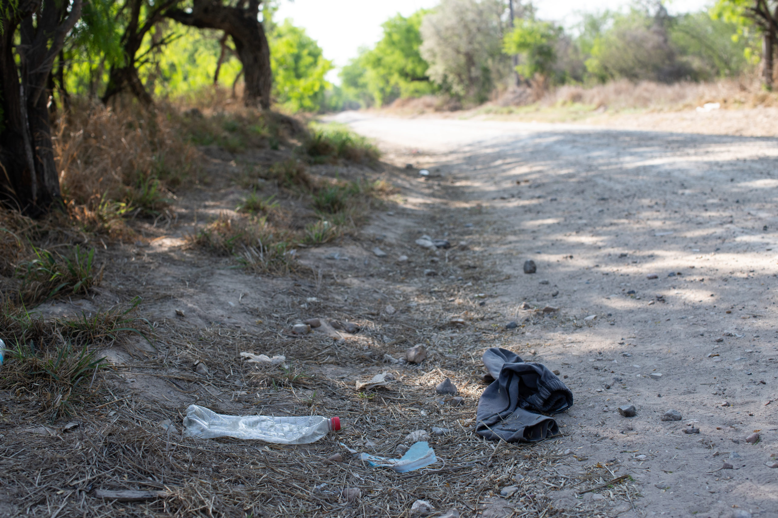 A private landowner has found increasing amounts of trash left behind by illegal migrants including medication, bags, clothing and bottles as they walk to a Customs and Border Protection field processing facility under the Anzalduas International Bridge near Mission, Texas, on March 26, 2021. (Kaylee Greenlee - Daily Caller News Foundation)