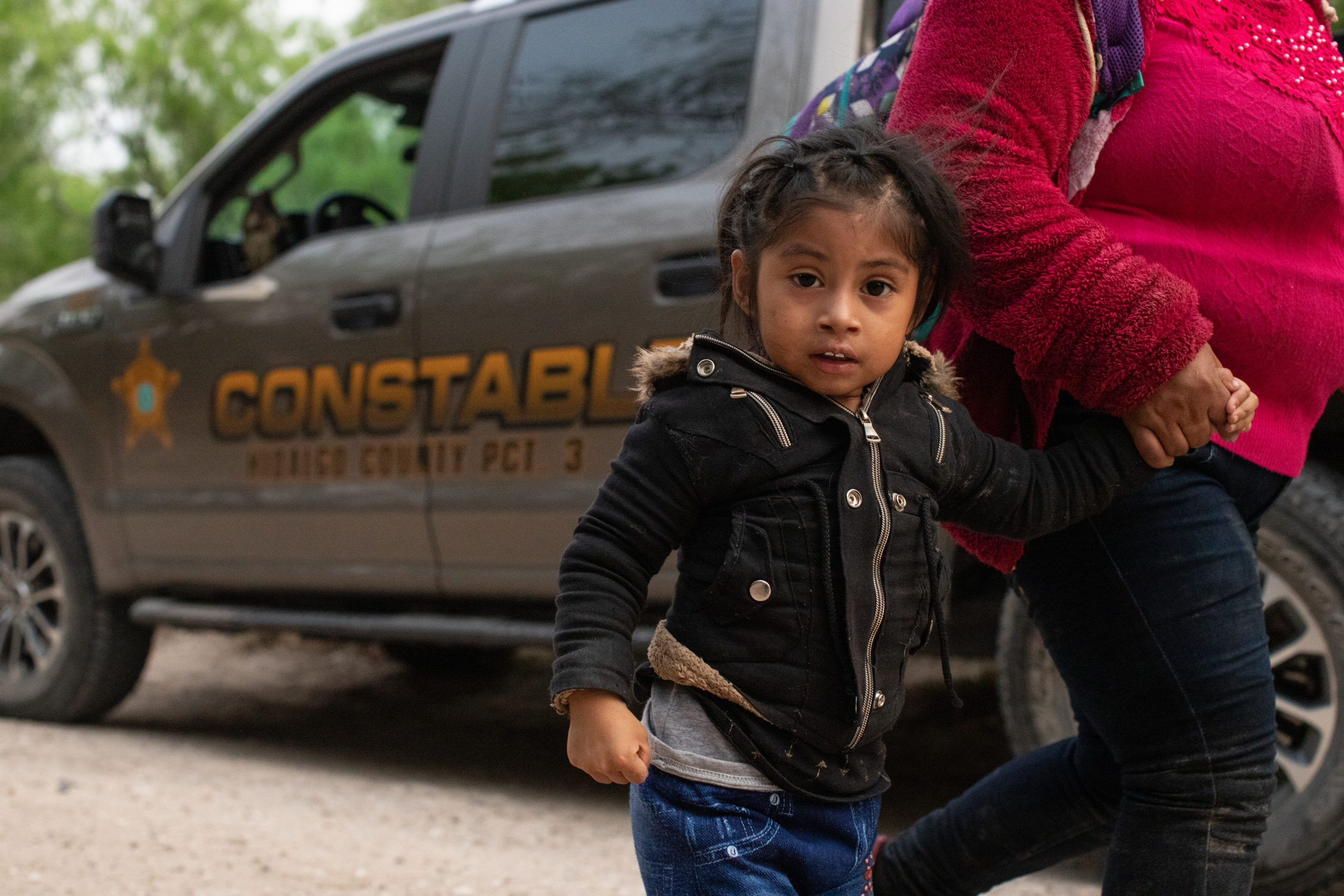 Illegal migrants make their way to a processing facility after they were smuggled into the U.S. and officials with the Hidalgo County Constable's office gathered biometrical data from them before releasing them in Rincon Village near McAllen, Texas, on March 24, 2021. (Kaylee Greenlee. - Daily Caller News Foundation)