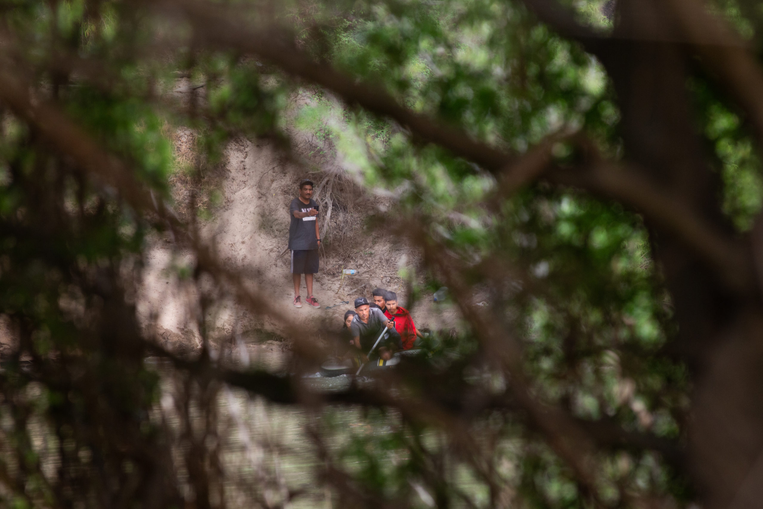 Smugglers use an inflatable raft to transport migrants across the Rio Grande River so they can illegally cross into the Rincon Village near McAllen, Texas, on March 24, 2021. (Kaylee Greenlee. - Daily Caller News Foundation)