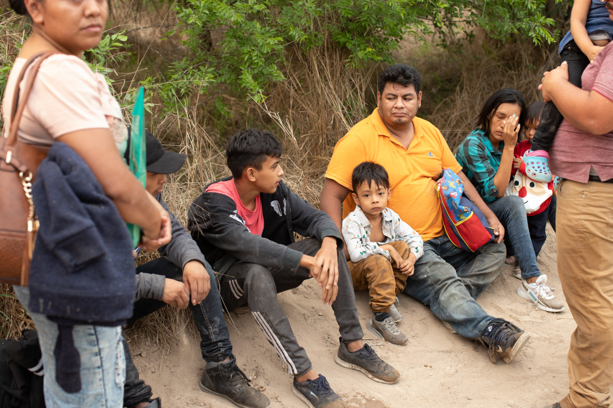 Officials with the Hidalgo County Constable's office gathers biometric data from illegal immigrants shortly after they were smuggled into the U.S. in Rincon Village near McAllen, Texas, on March 24, 2021. (Kaylee Greenlee. - Daily Caller News Foundation)